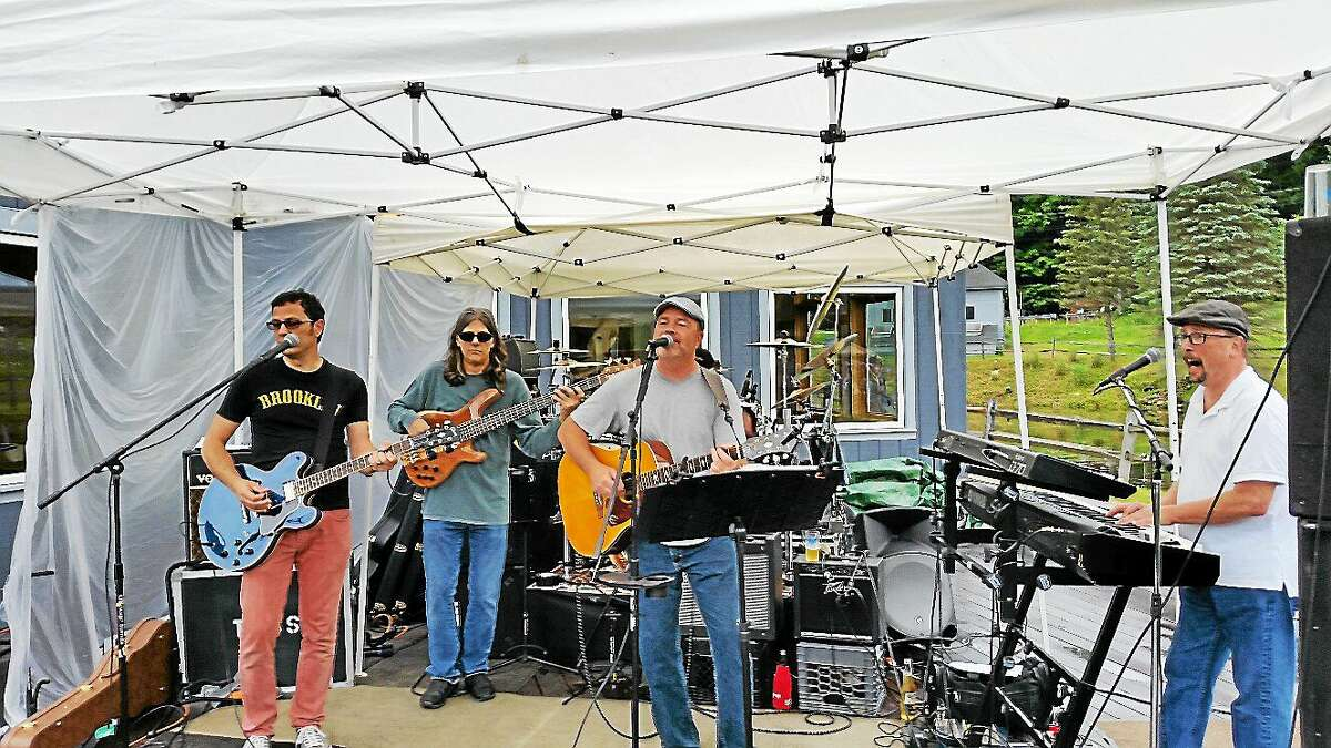 The local band Uncle Polly & The Family Jam performed classic rock songs under a tent at the 10th Annual Ski Sundown Summer Brewfest at Ski Sundown ski resort at 126 Ratlum Road in New Hartford on Saturday, June 20, 2015.