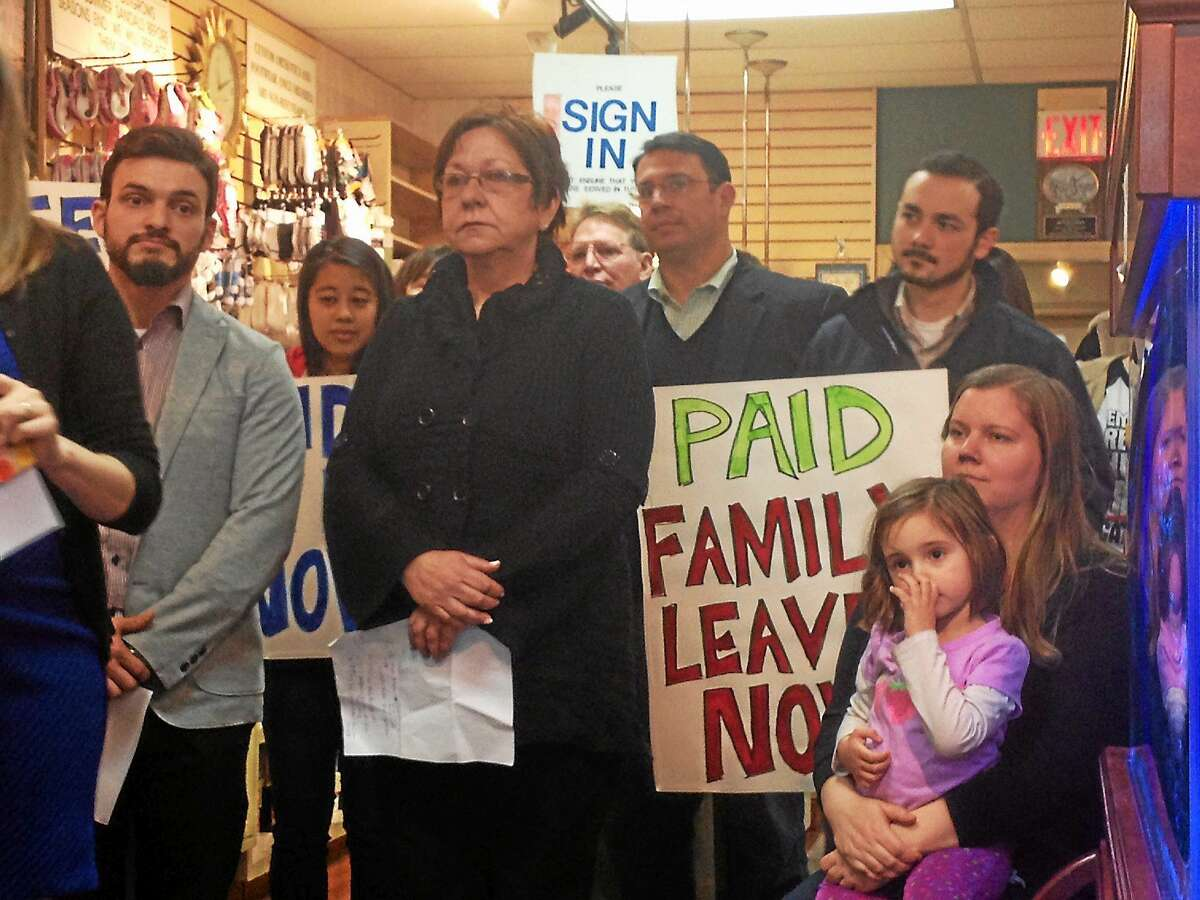 Matt Arciuolo, at left, owner of Arciuolo's Shoe Store in Milford, stands with supporters of a bill to establish paid family and medical leave in Connecticut.