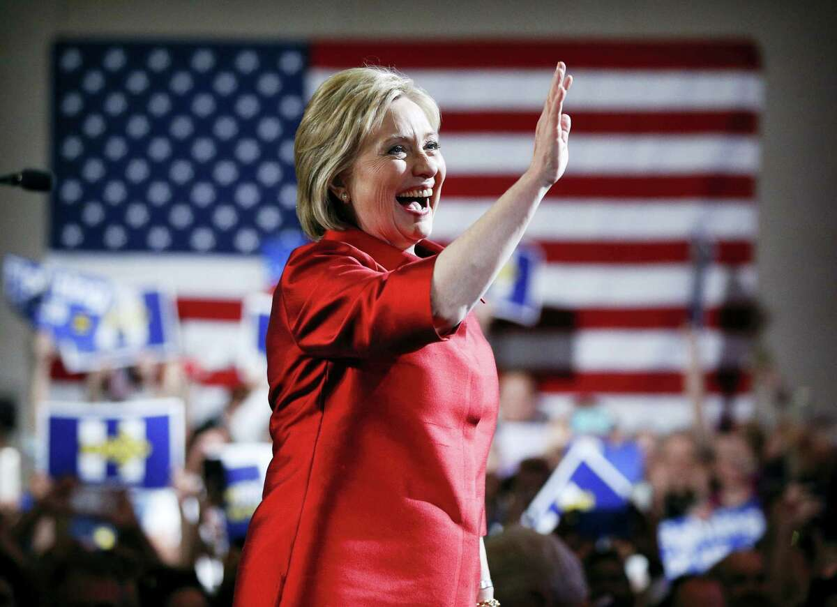 Democratic presidential candidate Hillary Clinton, waves at a Nevada Democratic caucus rally, Saturday, Feb. 20, 2016, in Las Vegas.