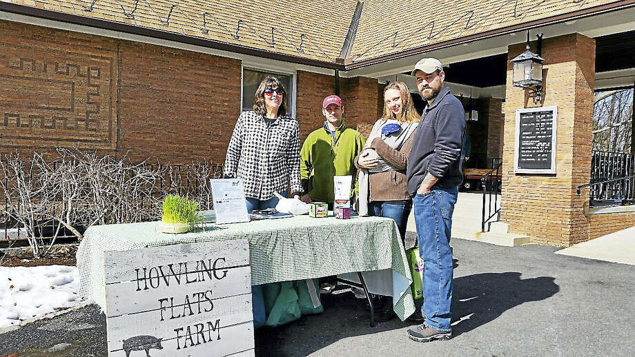 Kelley Babbin of Howling Flats Farm of North Canaan sold grass-fed, pasture-raised beef to Ellie and Chris Wellman (with three-week-old Mia) of Virginia as Jason Fuller of Grassy Knoll Farm of Riverton looked on during the 10th season of the Norfolk Farms Market in 53-degree sunny weather outside Norfolk Town Offices at 19 Maple Ave. in Norfolk on Saturday afternoon. Photo: NF AMBERY — REGISTER CITIZEN