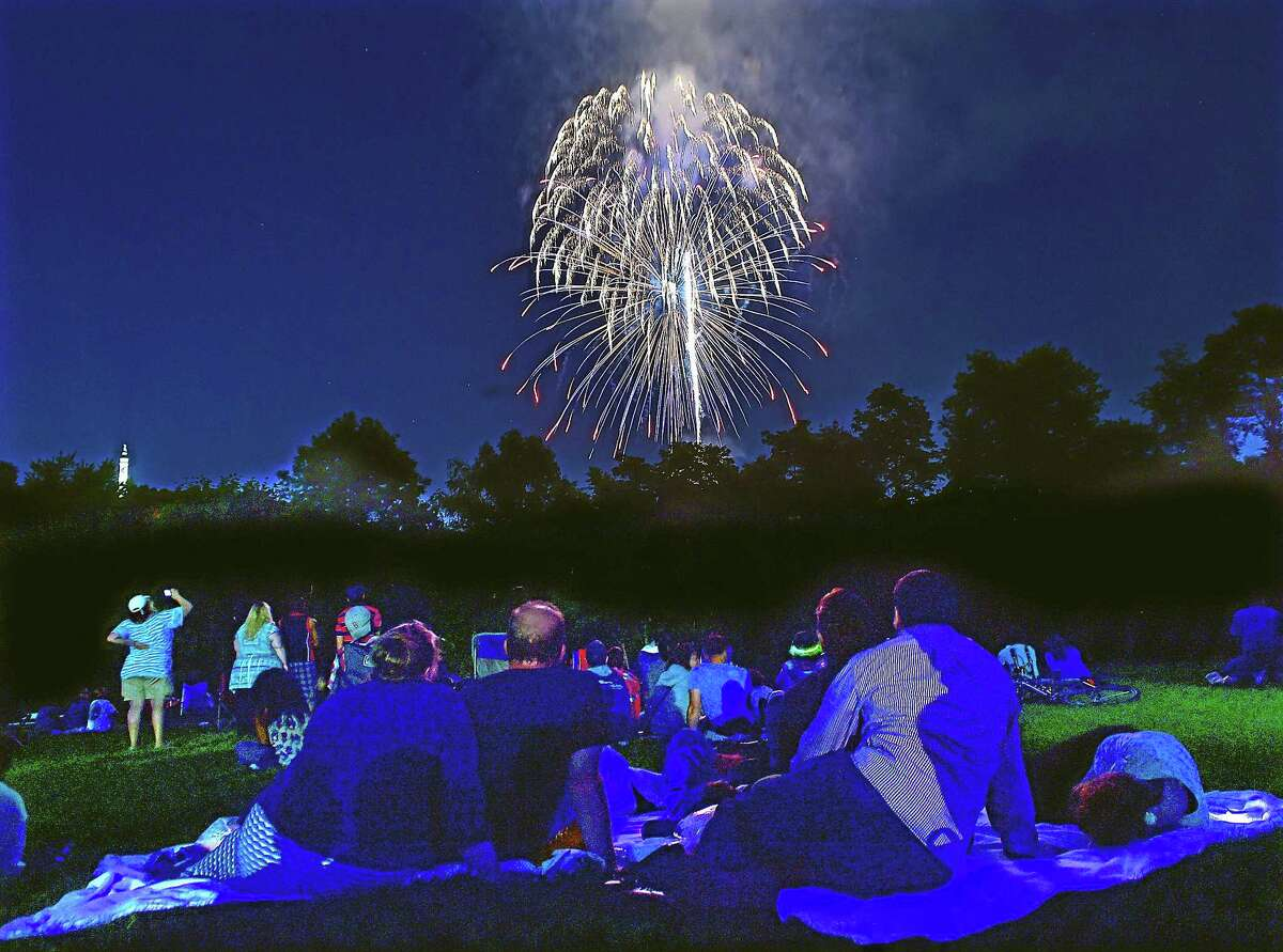 New Haven residents view the fireworks from the Wilbur Cross High School Athletic Complex in 2015.