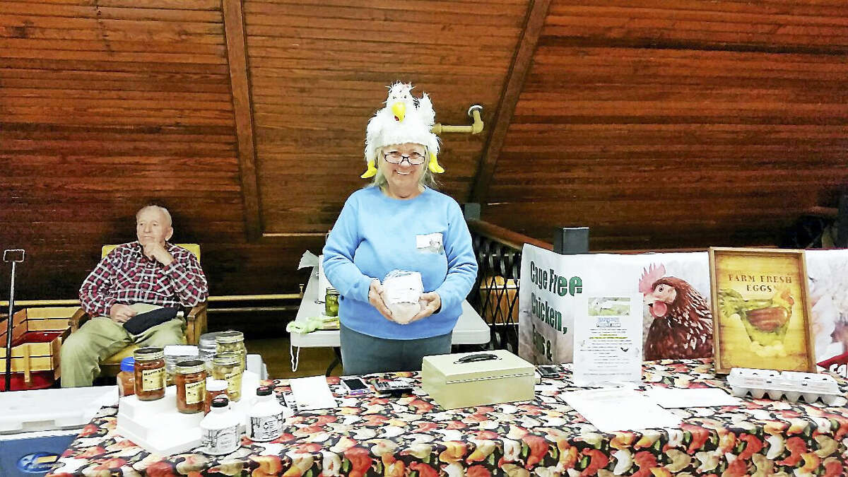 """""""The Chicken Lady"""" (a.k.a. Eleanore Provencal) sold eggs and other produce during the 10th season of the Norfolk Farms Market at the Norfolk Town Offices at 19 Maple Ave. in Norfolk on Saturday afternoon."""