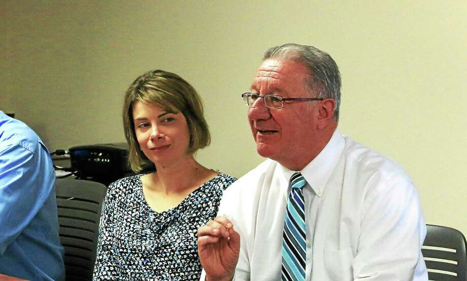 JOHN FITTS — THE REGISTER CITIZEN Owen Quinn, executive director of the United Way of Northwest Connecticut, and  Christina Emery, United Way Public Sector Campaign and LARC director of development, speak at a recent meeting of the Northwest Hills Council of Governments. Photo: Journal Register Co.