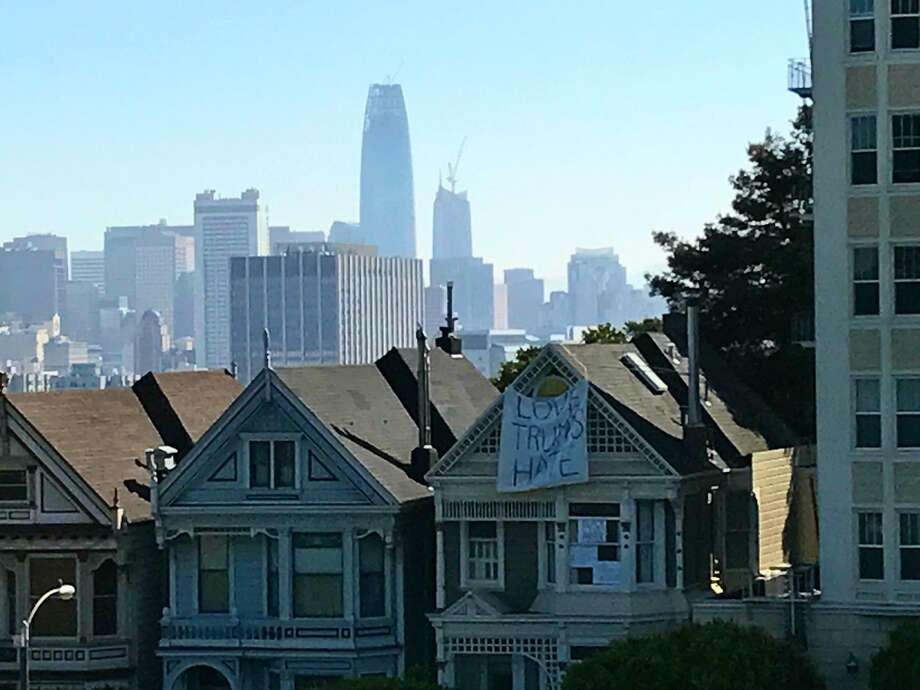 "A banner hangs from one of the ""Painted Ladies"" across from Alamo Square Park in San Francisco. Photo: Kurtis Alexander / Kurtis Alexander"