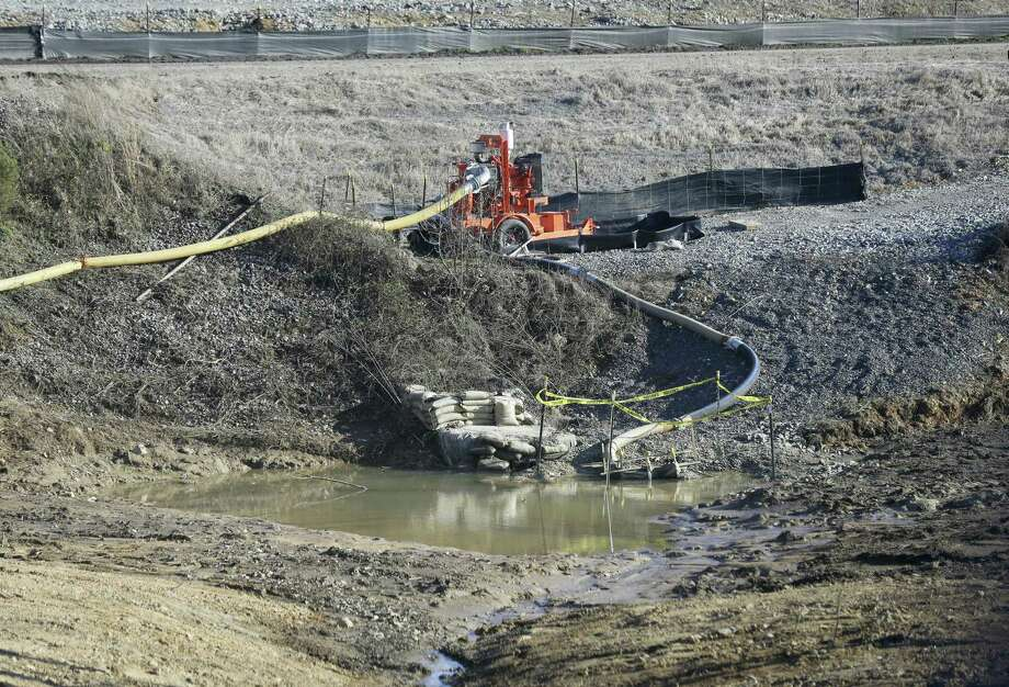 A drainage pipe that was the original culprit of the coal ash spill is shown at the Dan River Steam Station in Eden, N.C. Duke Energy Corp. is digging up and hauling away from riverbanks the toxic coal residues two years after one of the worst coal-ash spills in U.S. history. Photo: Gerry Broome — The Associated Press  / AP
