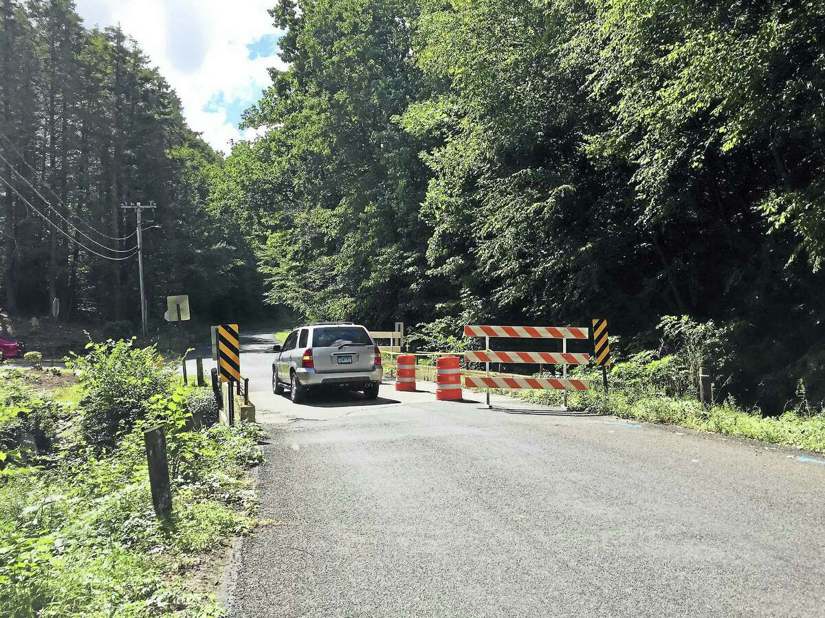 Ben Lambert - The Register Citizen Lovers Lane Bridge in Torrington, which can only be used by a single vehicle at a time. Its structural stability is a concern, and the city voted last week to repair it.