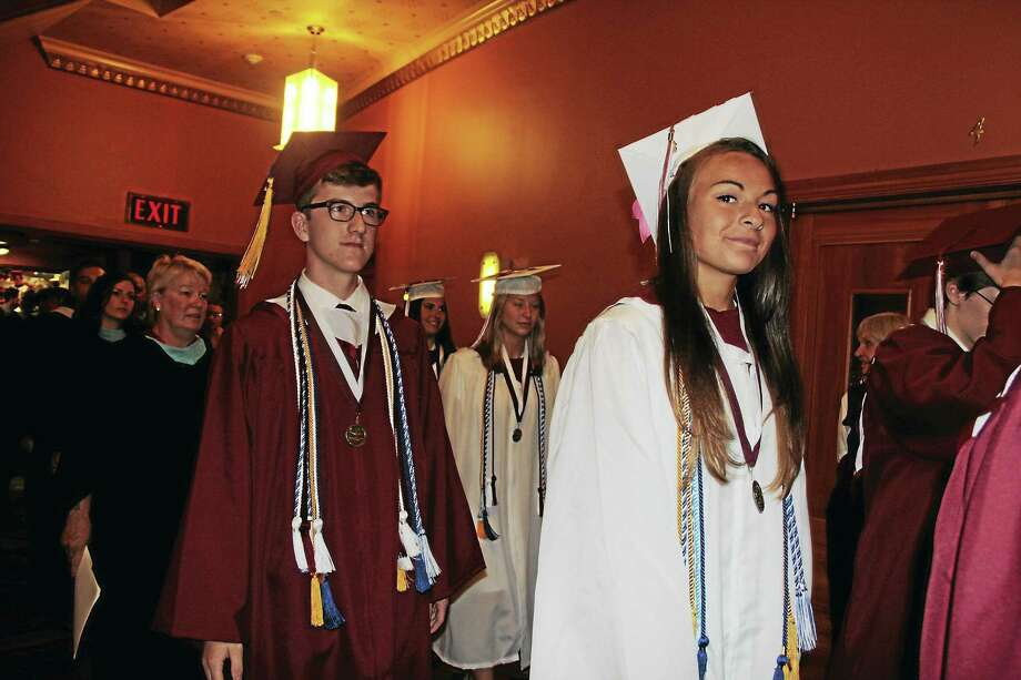 Anita Garnett -- Register-Citizen Teachers and students proceed into the Warner Theatre. Photo: Journal Register Co.