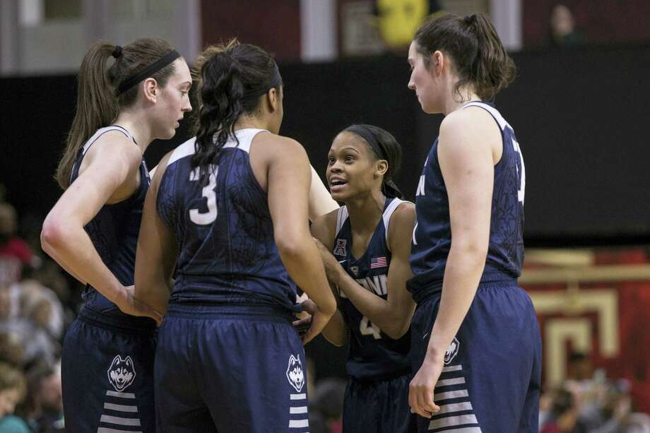 UConn's Moriah Jefferson (4) talks things over with her teammates during a recent game. Photo: The Associated Press File Photo  / FR170982 AP