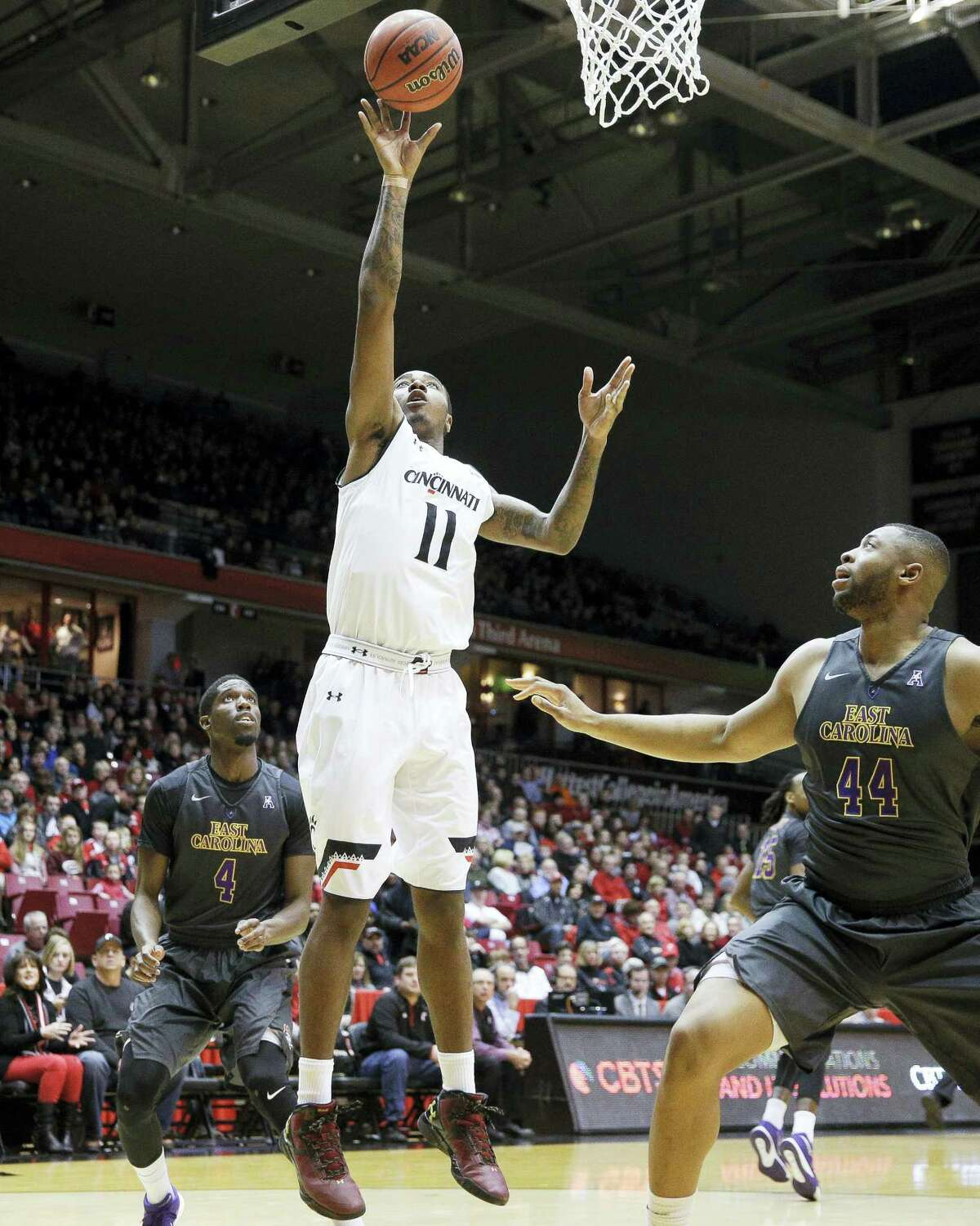 Cincinnati's Gary Clark (11) shoots over East Carolina's Kanu Aja (44) during a recent game.
