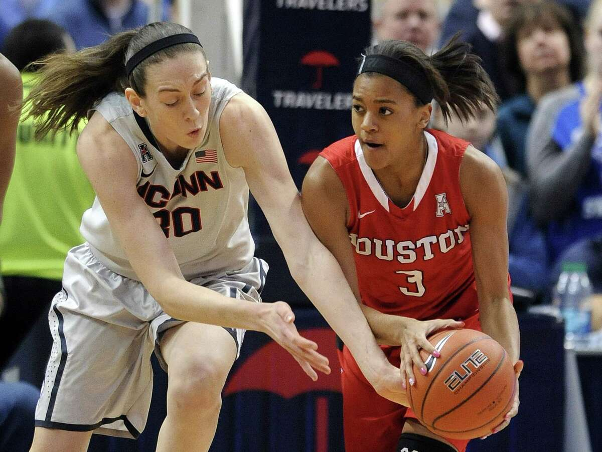 UConn's Breanna Stewart and Houston's Bianca Winslow (3) fight for a loose ball during the first half of the top-ranked Huskies' 85-26 win on Tuesday night at the XL Center in Hartford.