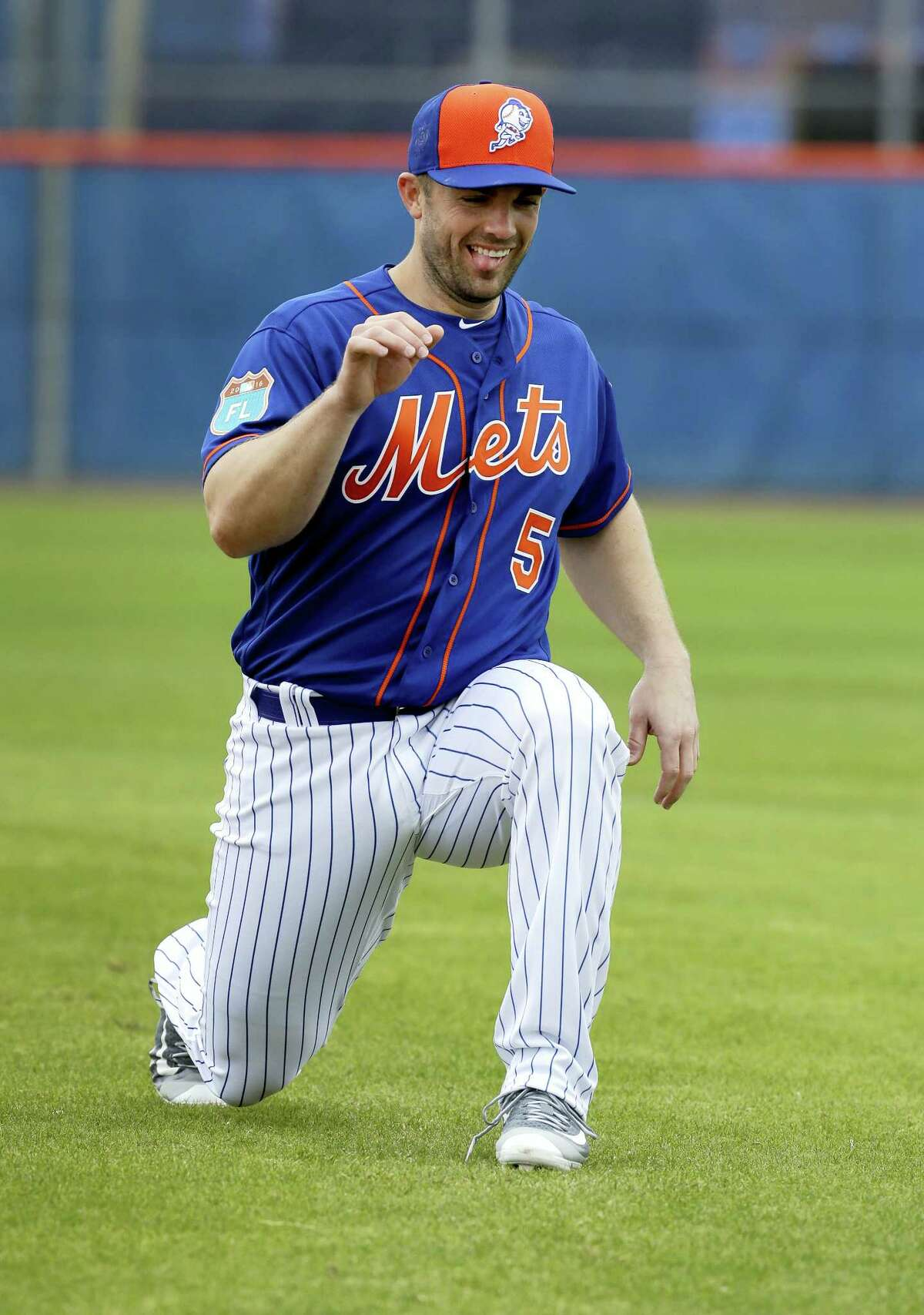 Mets third baseman David Wright warms up during practice on Friday in Port St. Lucie, Fla.