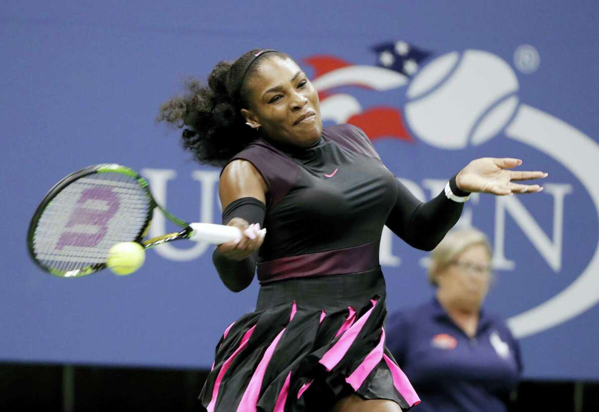 In this Aug. 30, 2016 photo, Serena Williams, of the United States, returns a shot from Ekaterina Makarova, of Russia, during the first round of the U.S. Open tennis tournament in New York. Williams released a new video Thursday, Sept. 1 on YouTube, featuring the 34-year-old performing various dance styles.