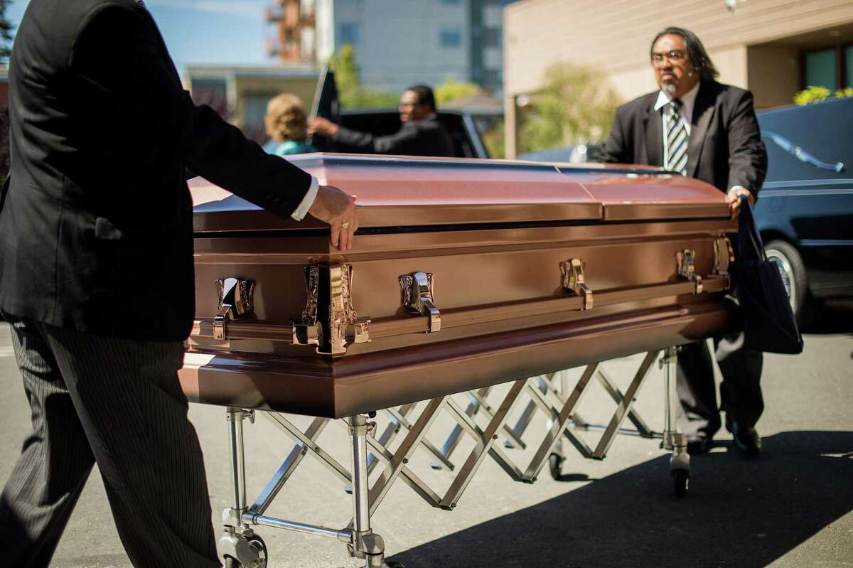 Funeral directors transport the body of an Irish student who died Tuesday when a Berkeley apartment balcony collapsed, Friday, June 19, 2015 in Oakland Calif. Caskets bearing four of the six victims arrived at St. Columba Catholic Church for a vigil Friday afternoon. (AP Photo/Noah Berger)