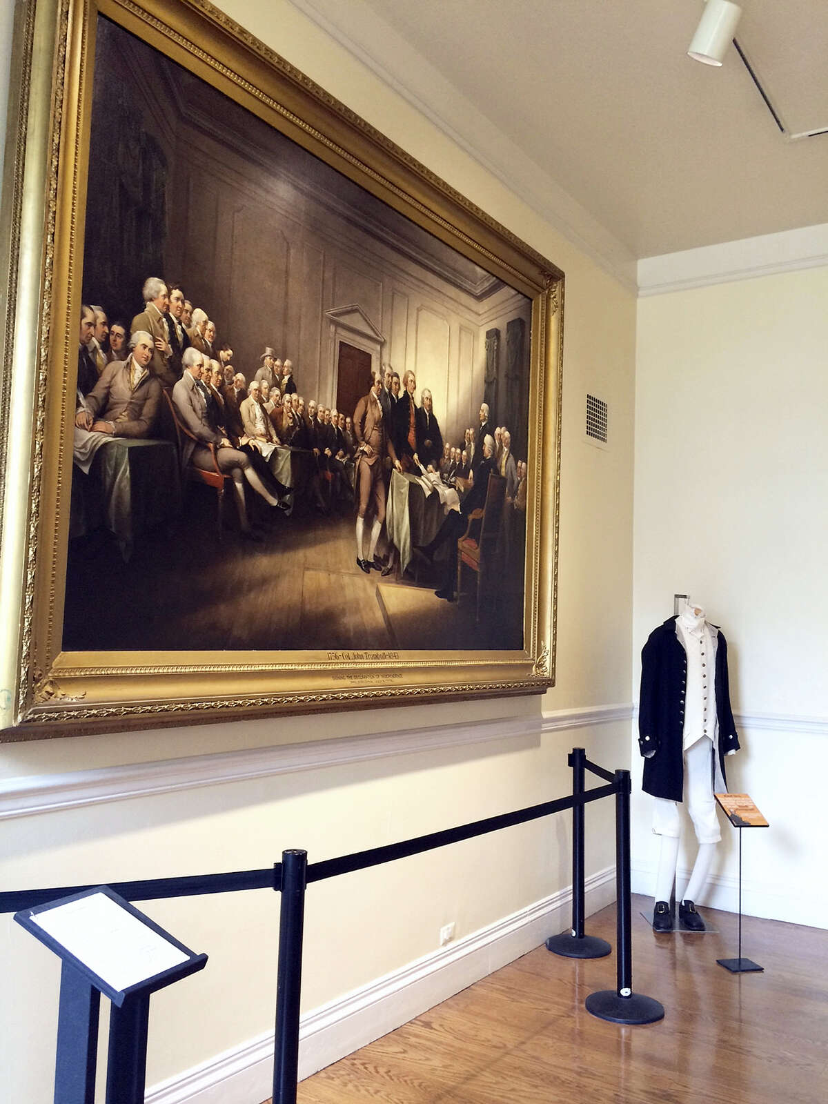 """An 1832 oil painting by John Trumbull, """"The Declaration of Independence, July 4, 1776,"""" hangs inside the former executive branch offices of the Old State House in Hartford. A larger version of the painting hangs in the U.S. Capitol Rotunda. The fate of the 220-year-old historic landmark is uncertain after state lawmakers transferred responsibility for the property to the state's environmental agency, which is struggling to cover millions of dollars in budget cuts."""