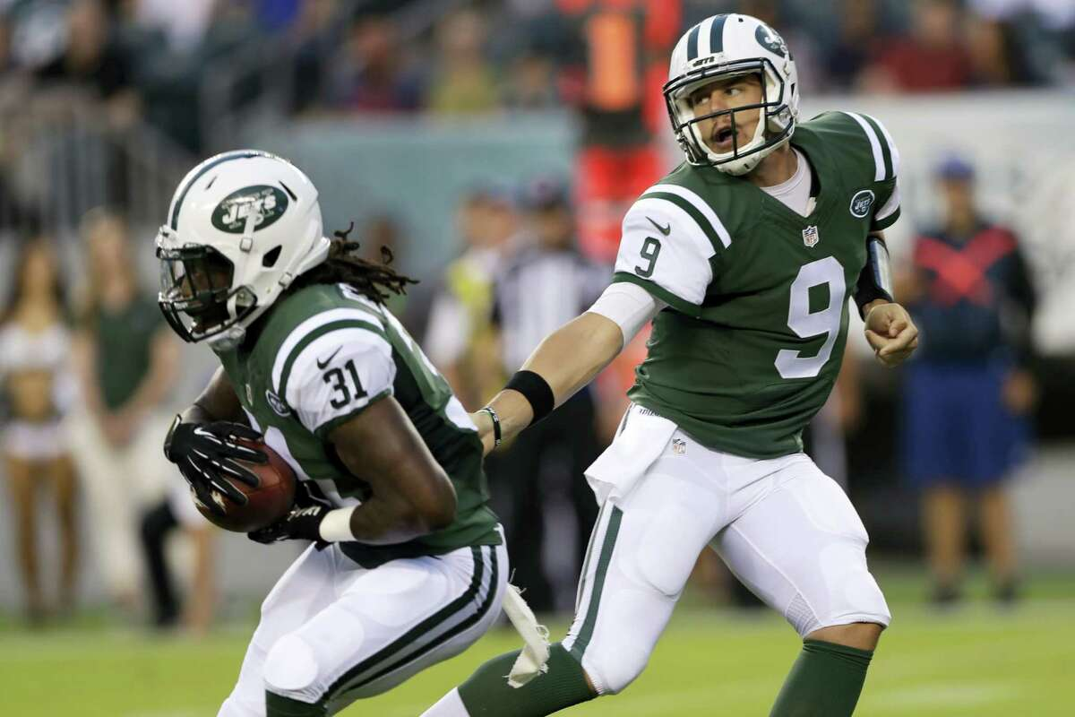 Bryce Petty (9) hands off to Khiry Robinson during the first half Thursday.