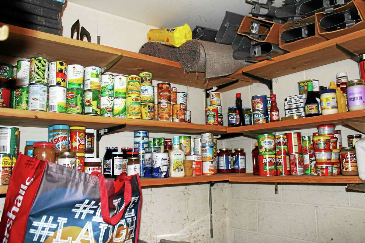 Photo by John NestorThe generosity of neighbors has stocked the shelves at the Colebrook Congregational Church Food pantry.