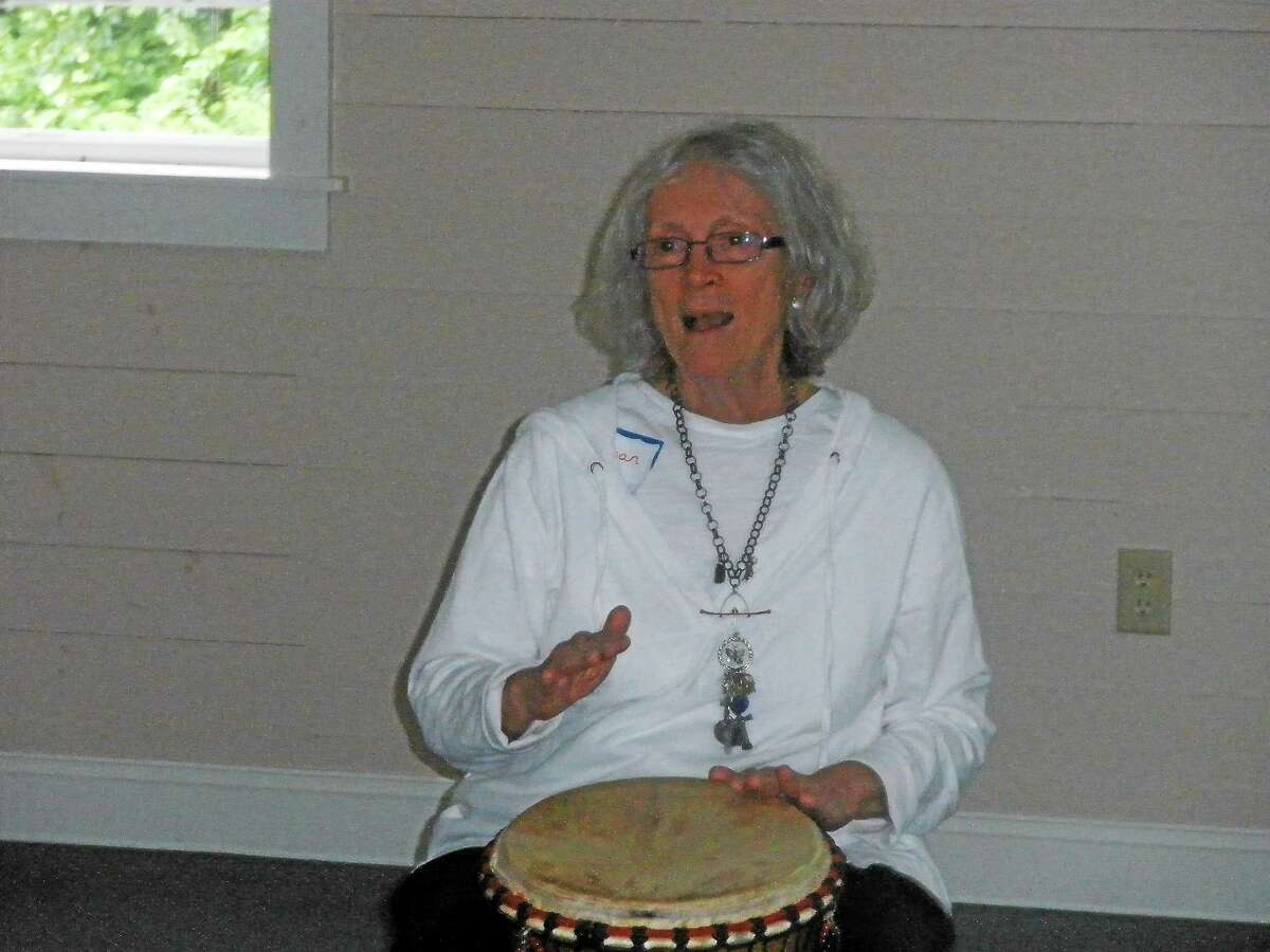 Susan Strand leads a rhythm on the drums at Wisdom House in Litchfield on Saturday, June 20, 2015.