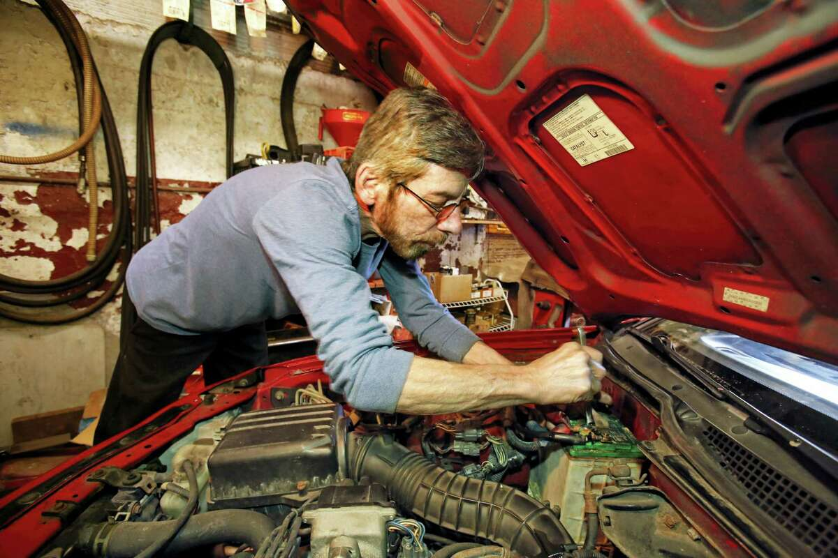 In this March 22, 2016, photo, auto mechanic Joe Valenti changes a battery in a Honda Acura at his garage in Dormont, Pa. Valenti has been keeping his customer's cars on the road since 1979. On June 28, 2016, the Commerce Department releases its third and final estimate of first-quarter gross domestic product.