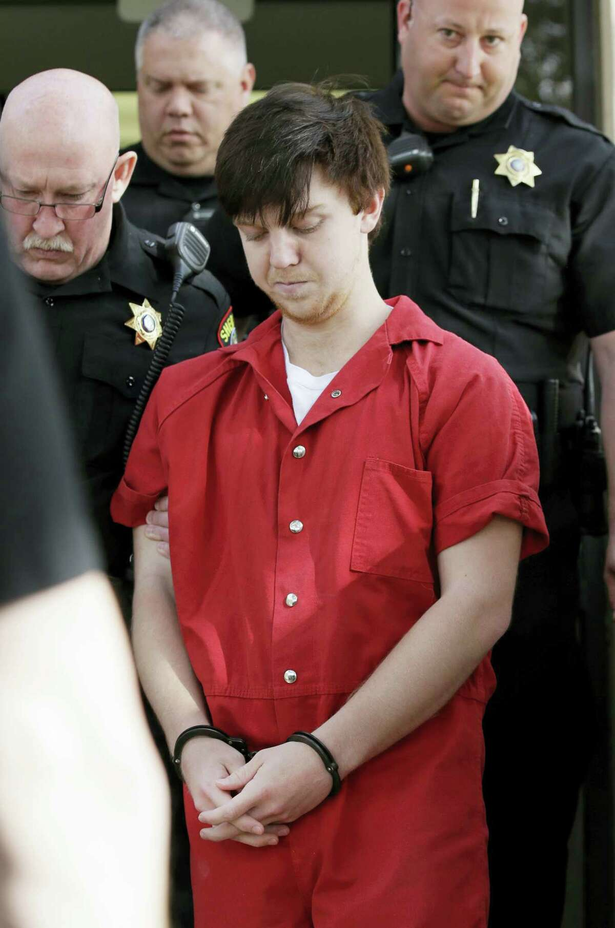"""Ethan Couch is led by sheriff deputies after a juvenile court for a hearing Friday, Feb. 19, 2016, in Fort Worth, Texas. A Texas judge ruled Couch, who used an """"affluenza"""" defense in a fatal drunken-driving wreck will be moved to adult court, meaning the teen could face jail time for the 2013 wreck that killed four people."""
