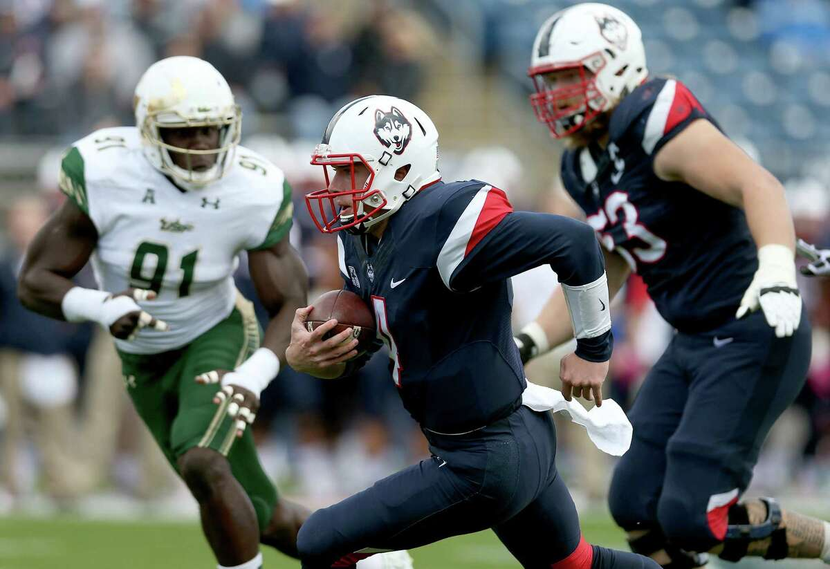 UConn quarterback Bryant Shirreffs (4) rushed for 100 yards and a touchdown and was 28-of-41 passing for 365 yards but it wasn't enough for the Huskies.