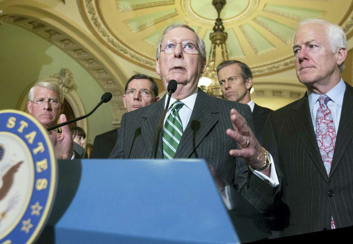 ASSOCIATED PRESS FILE PHOTO Senate Majority Leader Mitch McConnell of Kentucky, at microphone, in this file photo from Feb. 9.