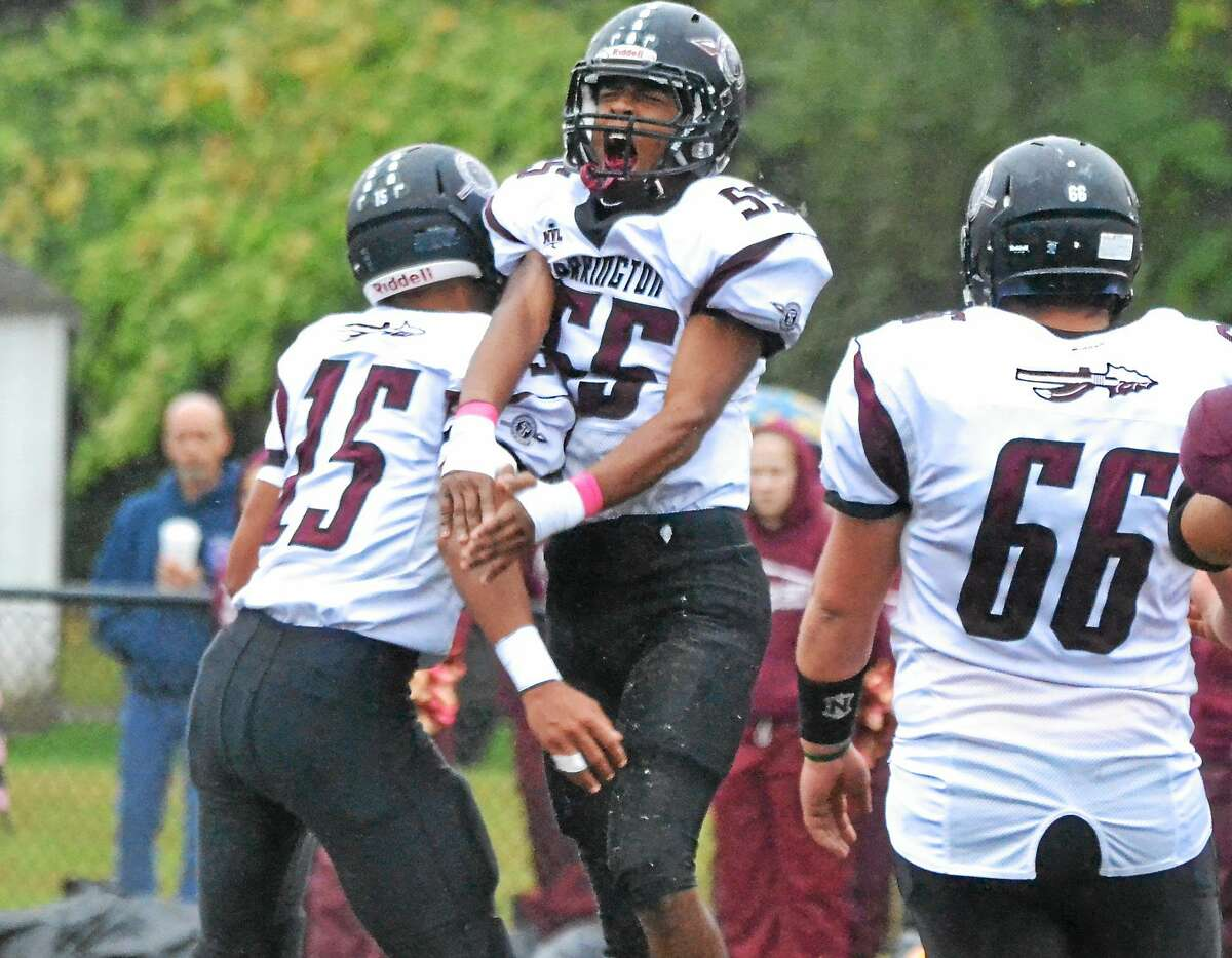 Pete Paguaga - New Haven Register ¬ Torrington's Luidi Perez celebrates after making a tackle in the backfield.