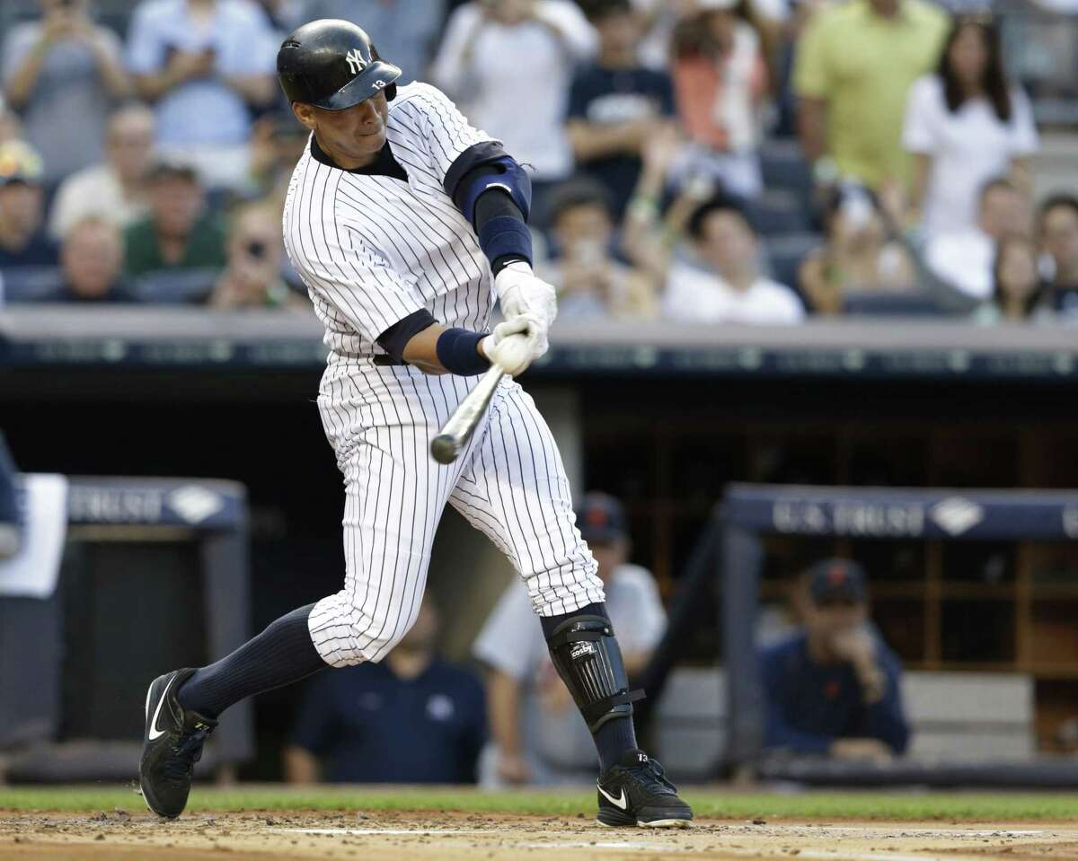 New York Yankees' Alex Rodriguez hits a home run for his 3,000th career hit, during the first inning of a baseball game against the Detroit Tigers on Friday, June 19, 2015, in New York. (AP Photo/Frank Franklin II)