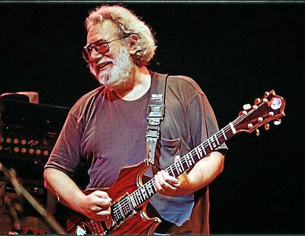 FILE--This Nov. 1, 1992 file photo shows Grateful Dead lead singer Jerry Garcia performing in Oakland , Calif. Garcia, who died on Aug. 9, 1995, Cyndi Lauper and Toby Keith will be inducted into the Songwriters Hall of Fame in June. The organization announced Wednesday that Linda Perry, country music songwriter Bobby Braddock and ?Hoochie Coochie Man? writer Willie Dixon will also be inducted on June 18. (AP Photo/Kristy McDonald, File)