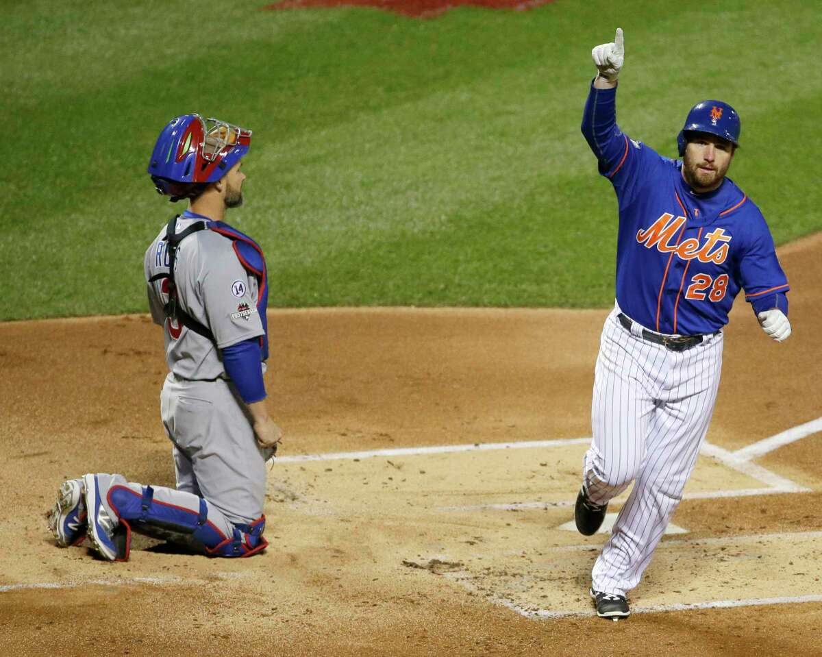 The Mets' Daniel Murphy celebrates in front of Cubs catcher David Ross after hitting a home run during the first inning Saturday.
