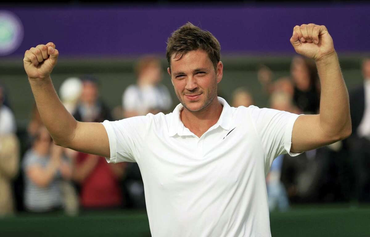 Britain's Marcus Willis celebrates his victory over Ricardas Berankis in the opening round of Wimbledon on Monday.