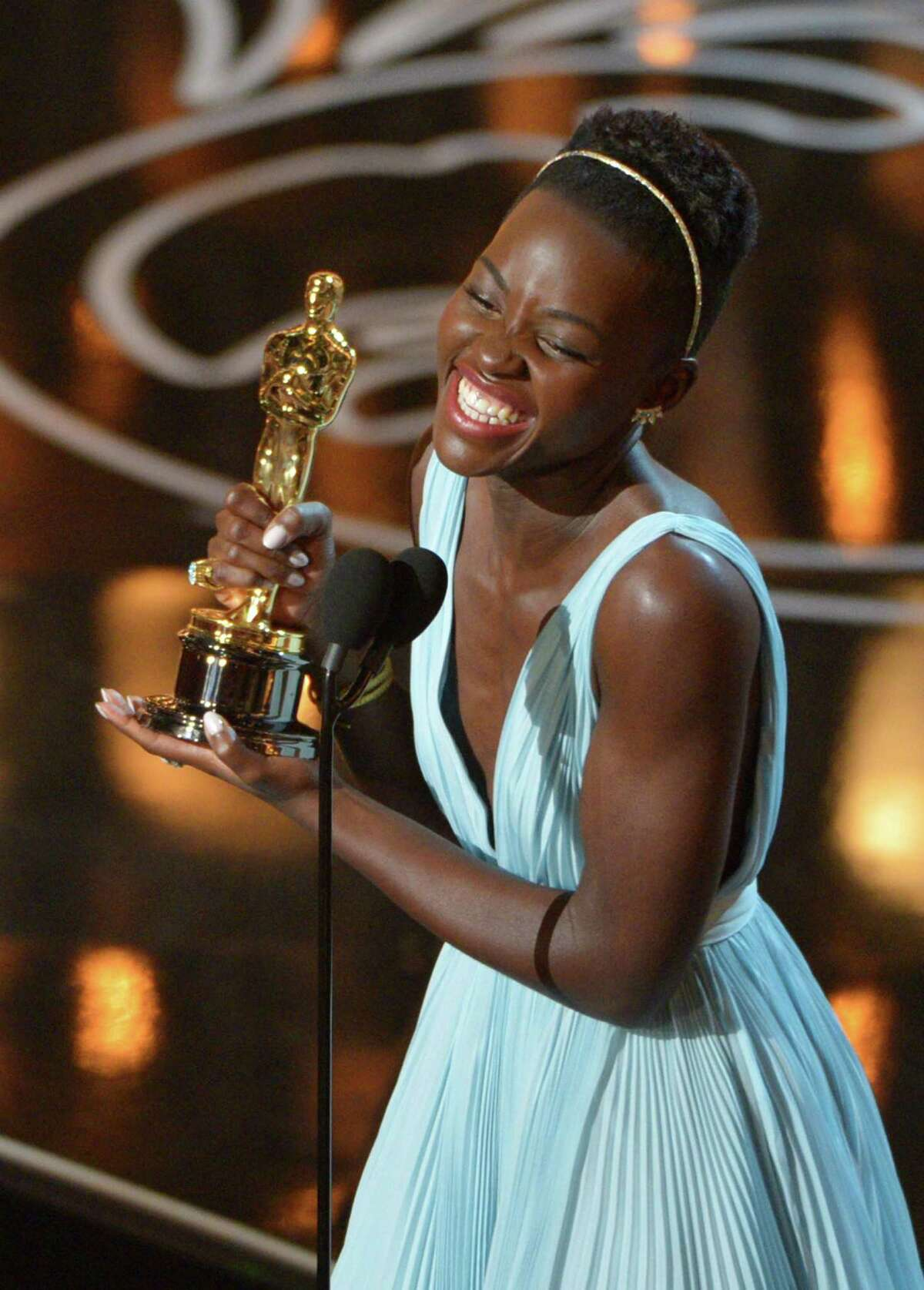 FILE - In this March 2, 2014 file photo, Lupita Nyongío accepts the award for best actress in a supporting role for