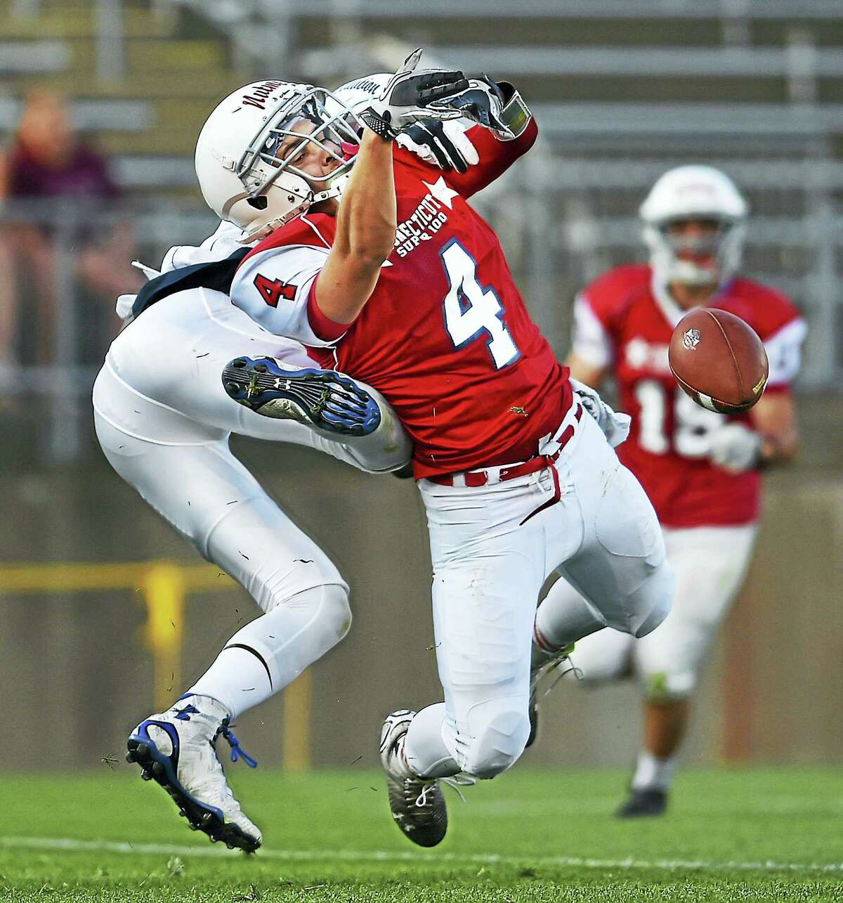(Catherine Avalone/New Haven Register) A Constitution defenseman breaks up a pass intended for Nutmeg's Anthony Caramanica - Xavier, Saturday, June 25, 2016, in the Super 100 Classic 2016 High School Senior All-Star Football game sponsored by the Connecticut High School Coaches Association. Team Constitution defeated Team Nutmeg, 33-9.