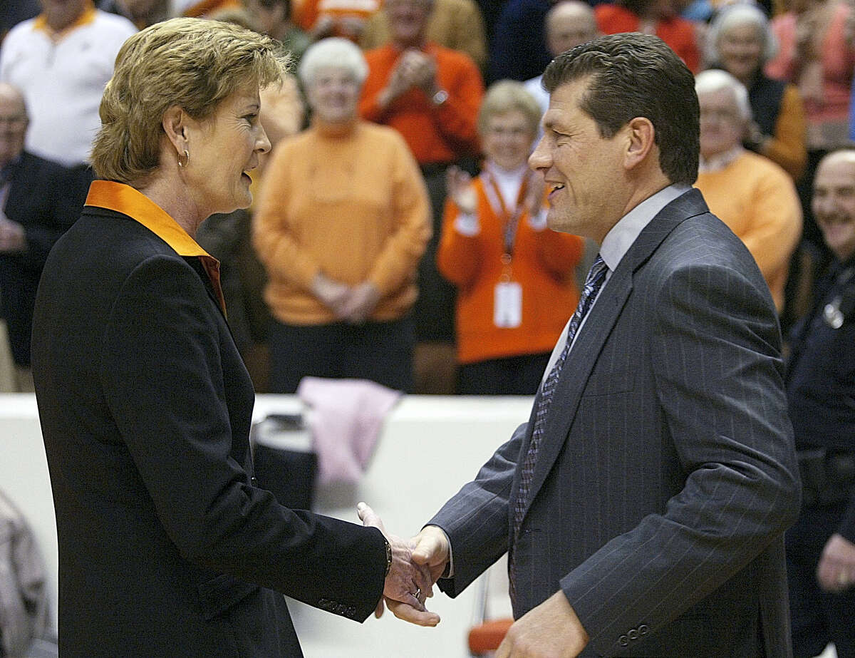 In this 2006 photo, Tennessee coach Pat Summitt, left, shakes hand with UConn coach Geno Auriemma.