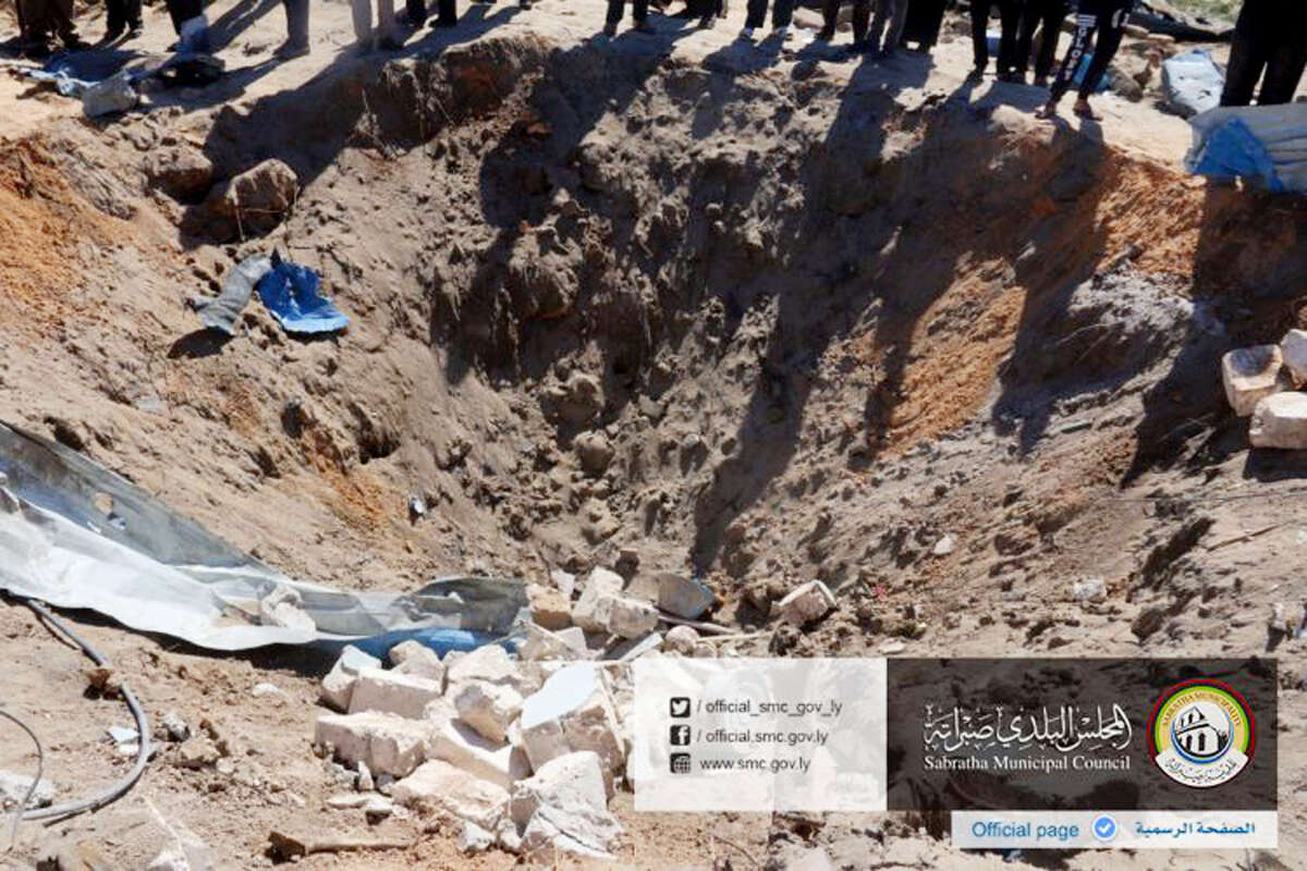 In this picture released online by the Sabratha Municipal Council on Friday, Feb. 19, 2016 shows the site where U.S. American warplanes struck an Islamic State training camp in Sabratha, Libya near the Tunisian border.