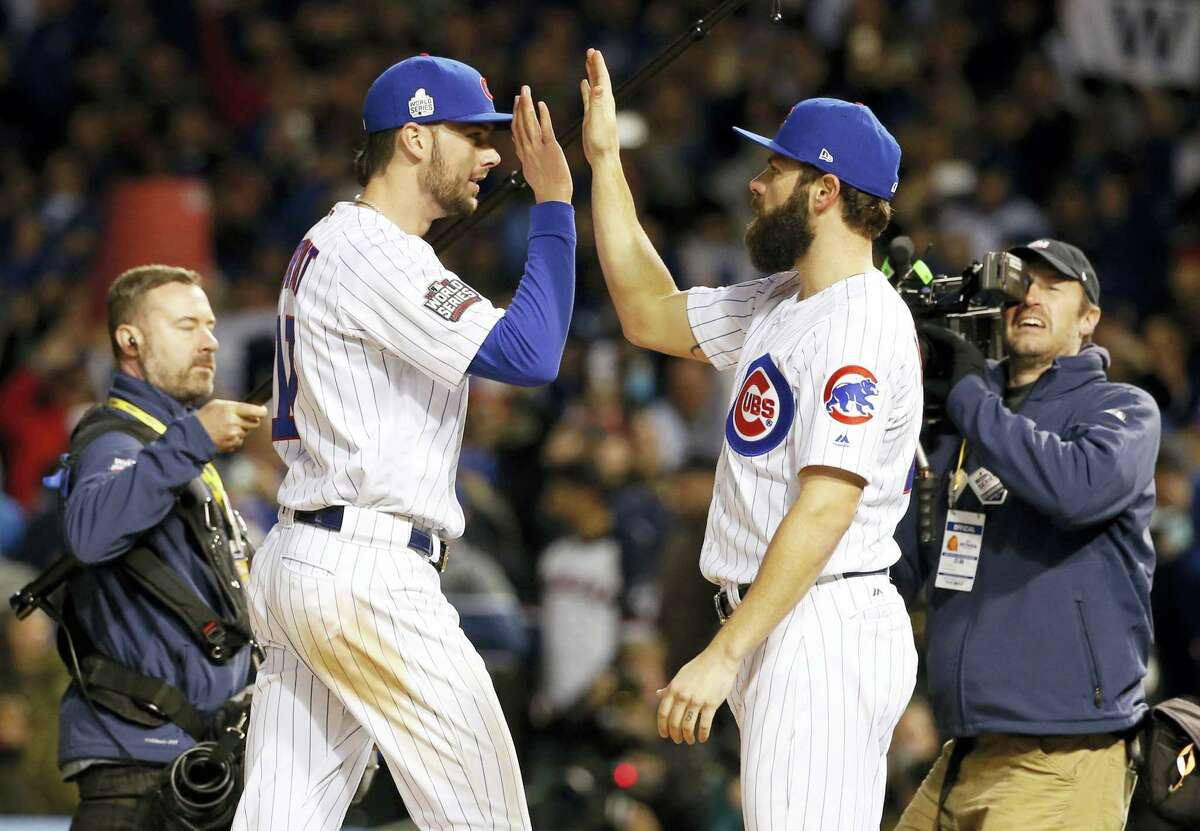 Chicago Cubs' Kris Bryant, left, celebrates with Jake Arrieta after Game 5 of the Major League Baseball World Series against the Cleveland Indians on Oct. 30, 2016 in Chicago. The Cubs won 3-2 as the Indians lead the series 3-2.