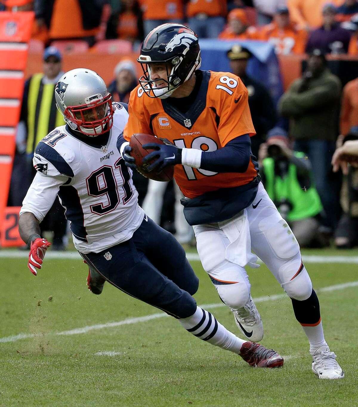 Broncos quarterback Peyton Manning evades a tackle by Patriots linebacker Jamie Collins.