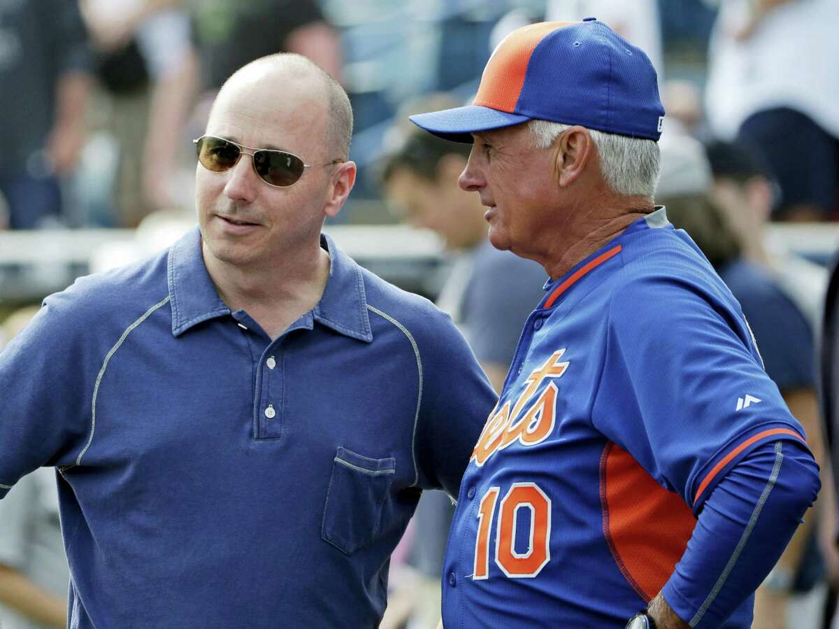 Yankees general manager Brian Cashman, left, talks to Mets manager Terry Collins before an exhibition game last year in Tampa, Fla.