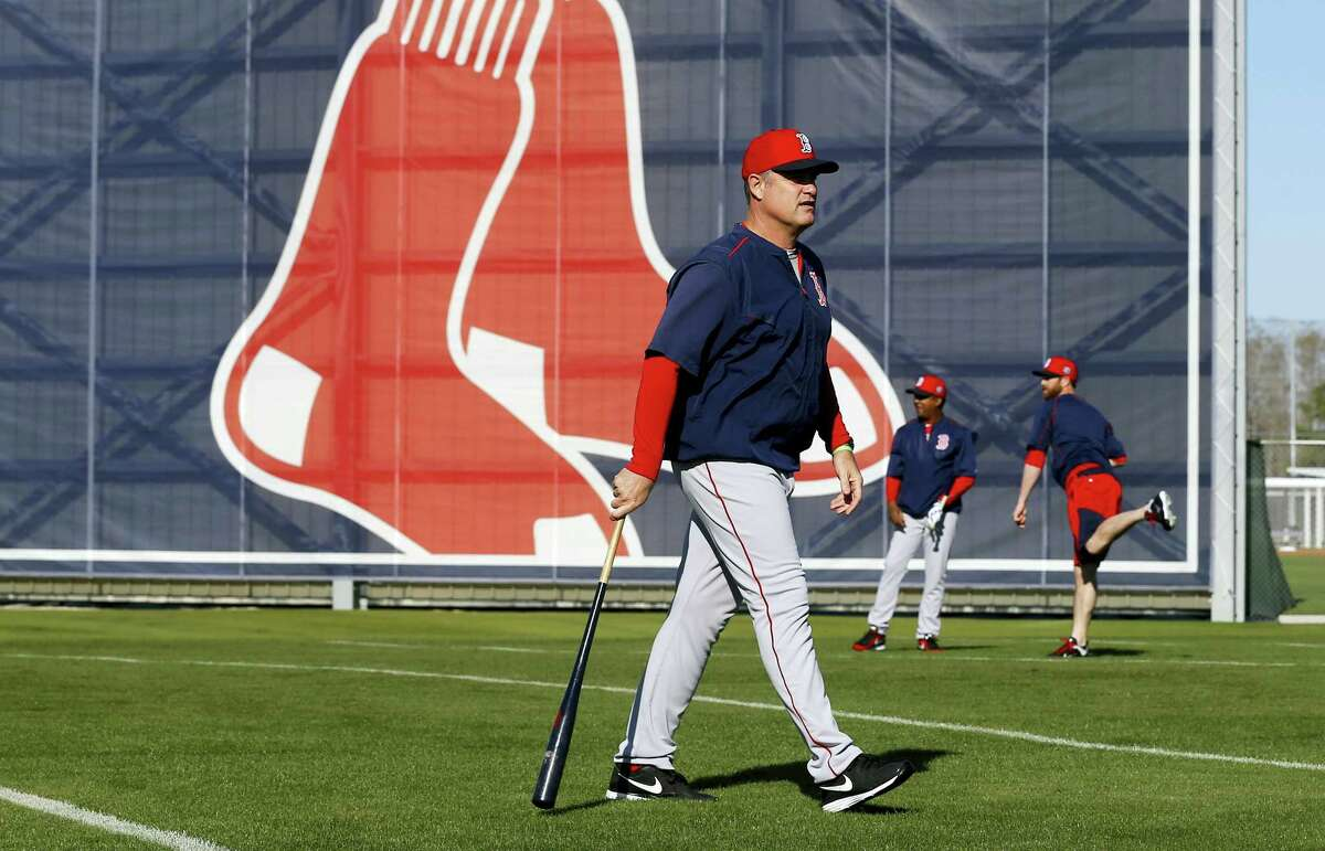Red Sox manager John Farrell walks on a field during practice in Fort Myers, Fla., on Thursday.