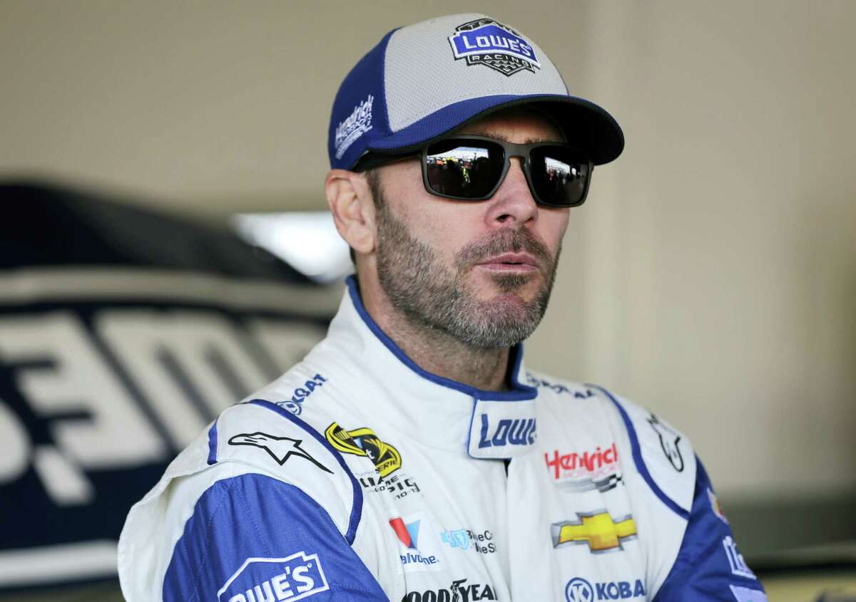 Jimmie Johnson looks from the garage area during practice for Sunday's Daytona 500.