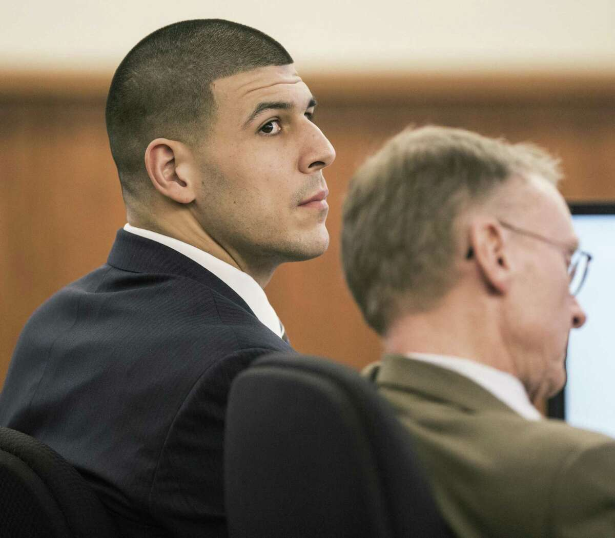 Aaron Hernandez sits with his attorney Charles Rankin during the former New England Patriots tight end's murder trial on Friday in Fall River, Mass.