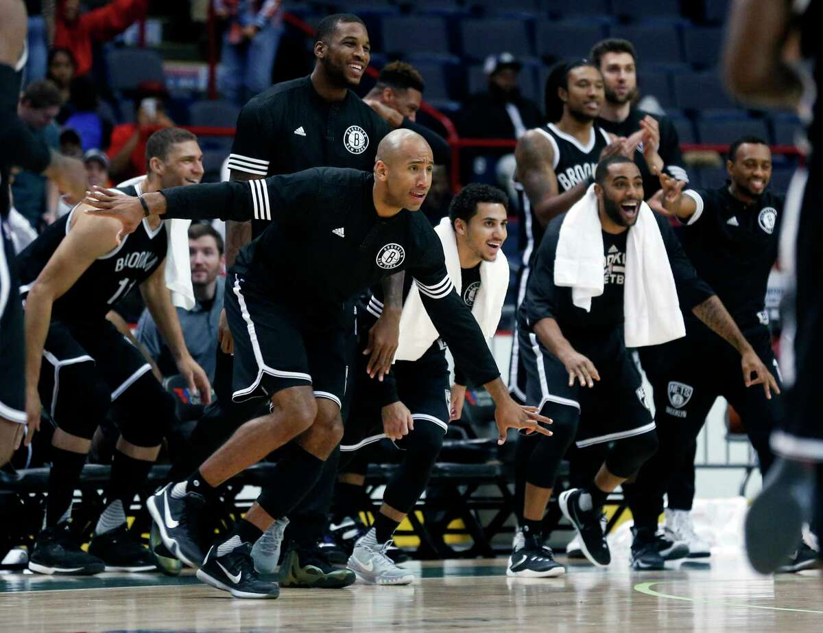 Brooklyn Nets players react during the second half of a preseason game against the Philadelphia 76ers on Oct. 10 in Albany, N.Y.