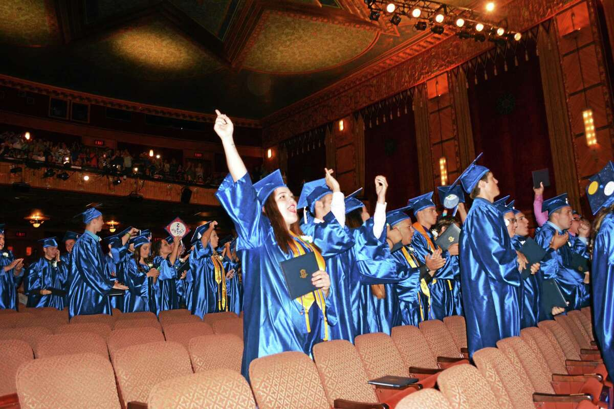 Members of the Oliver Wolcott Technical High School class of 2015 celebrate commencement Friday at the Warner Theater.