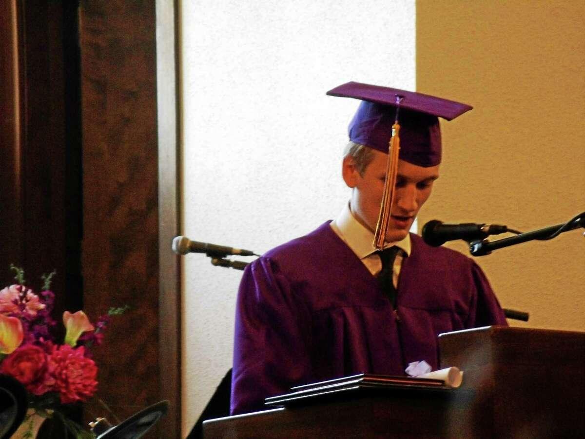 Torrington Christian Academy senior Nicolas Roy addresses the crowd during his speech at graduation Friday.