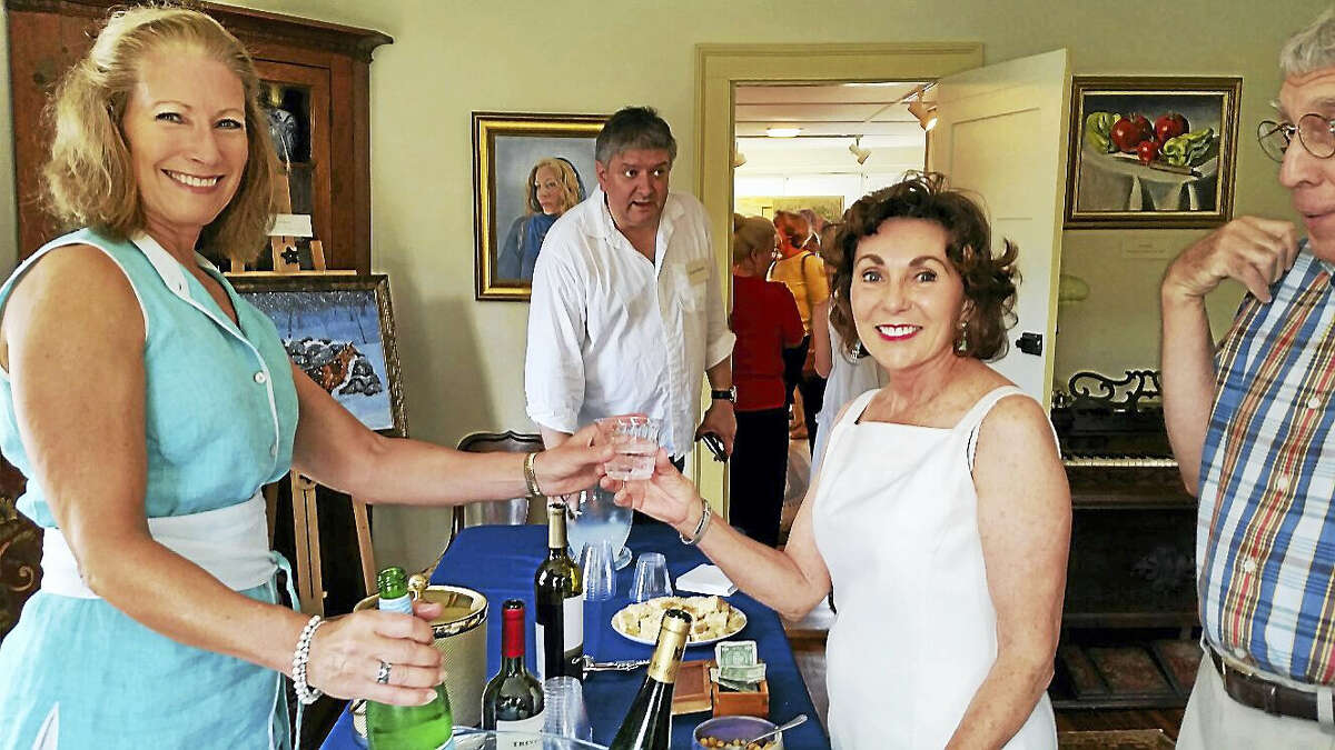 """Photo by N.F. AmberyColebrook Historical Society President Carol Lord serves beverages to visitors at the Historical Society's 2016 group art show """"Artists Abound"""" at 558 Colebrook Road in Colebrook on Sunday afternoon. About 300 people attended the open house and art show and sale that featured 20 local artists and craftspeople."""