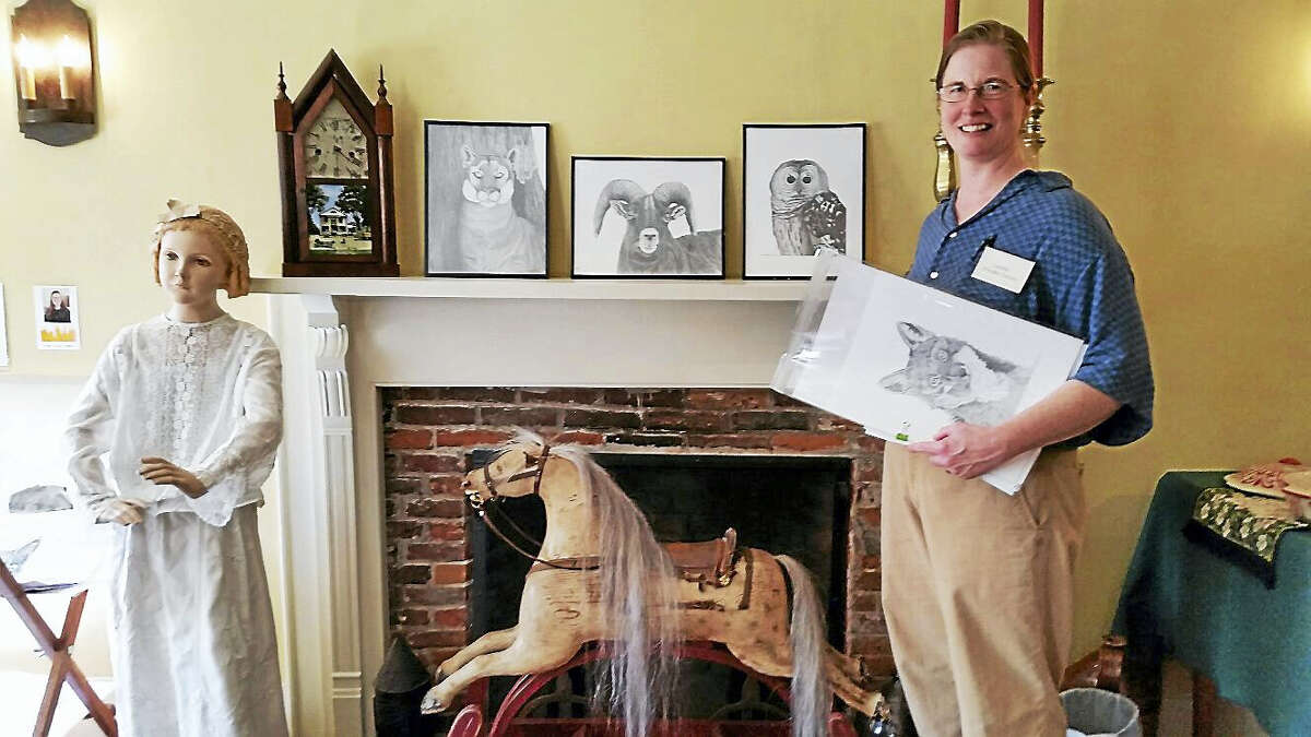 """Photo by N.F. AmberySandisfield, Massachusetts, resident Laurie Foulke-Green shows her nature-themed pencil drawings at the Historical Society's 2016 group art show """"Artists About"""" at 558 Colebrook Road in Colebrook on Sunday afternoon. About 300 people attended the open house and art show and sale that featured 20 local artists and craftspeople."""