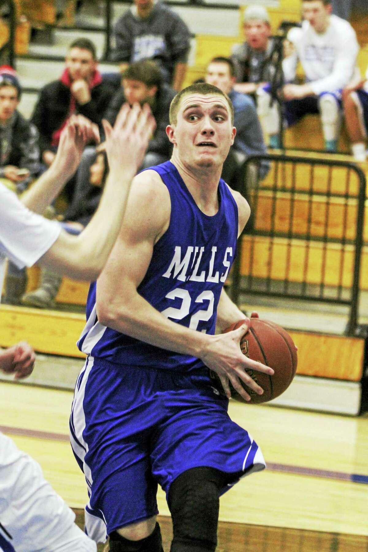 Lewis Mills' Trevor Baker makes a move in a Spartan hammer-and-tong win at Litchfield.