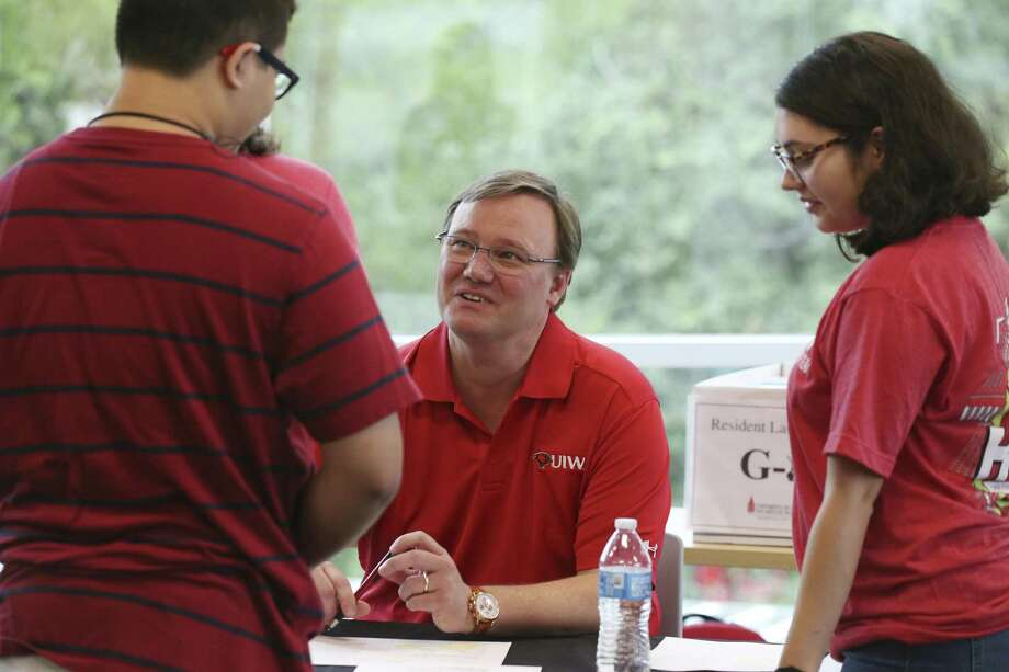 University of the Incarnate Word President Thomas Evans greets incoming freshmen at the new Student Center Aug. 24. Evans took over the position from Louis Agnese who led the university for three decades but left under a swirl of controversy. Photo: JERRY LARA /San Antonio Express-News / San Antonio Express-News