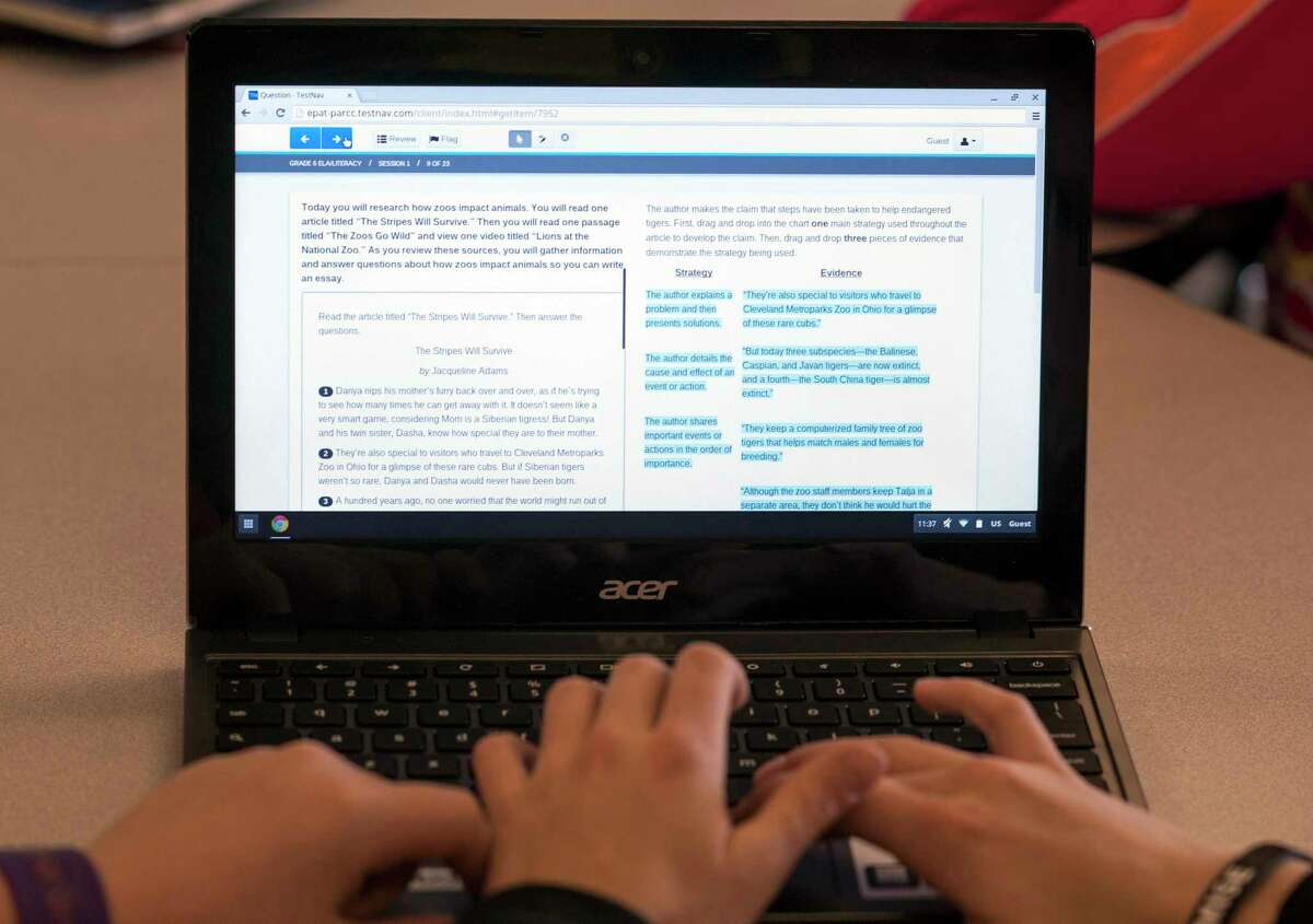 Students in Carrie Young's sixth-grade class work through an exercise on their laptops during a practice session to prepare for the the Common Core State Standards Test at Morgan Elementary School South in Stockport, Ohio.