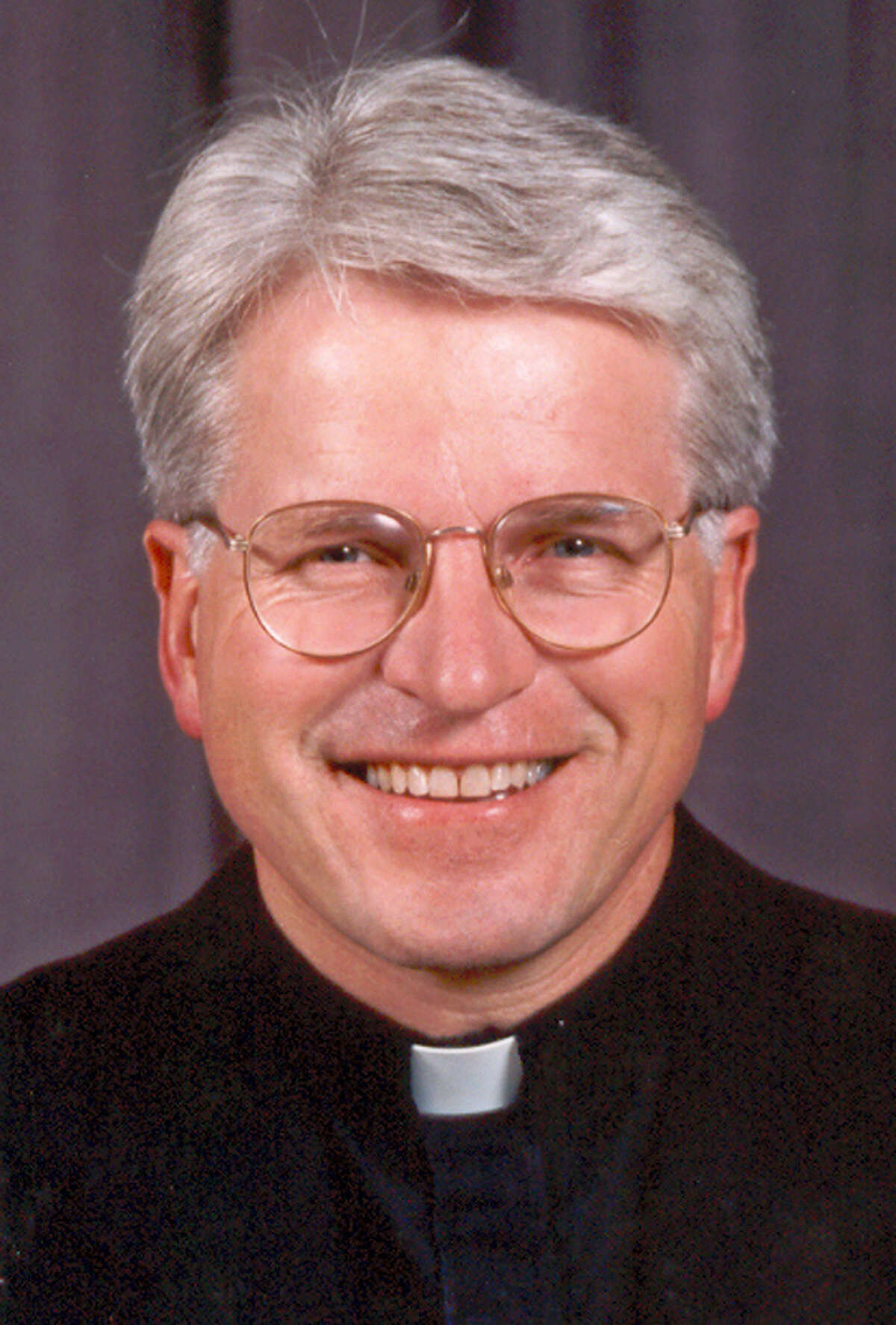 """This undated photo provided by the Diocese of Rockville Centre shows Monsignor Thomas J. Hartman, a Roman Catholic priest who gained fame as half of an interfaith """"God Squad"""" duo on television, died Tuesday, Feb. 16, 2016, in a Uniondale, N.Y. nursing home. He was 69 years old."""
