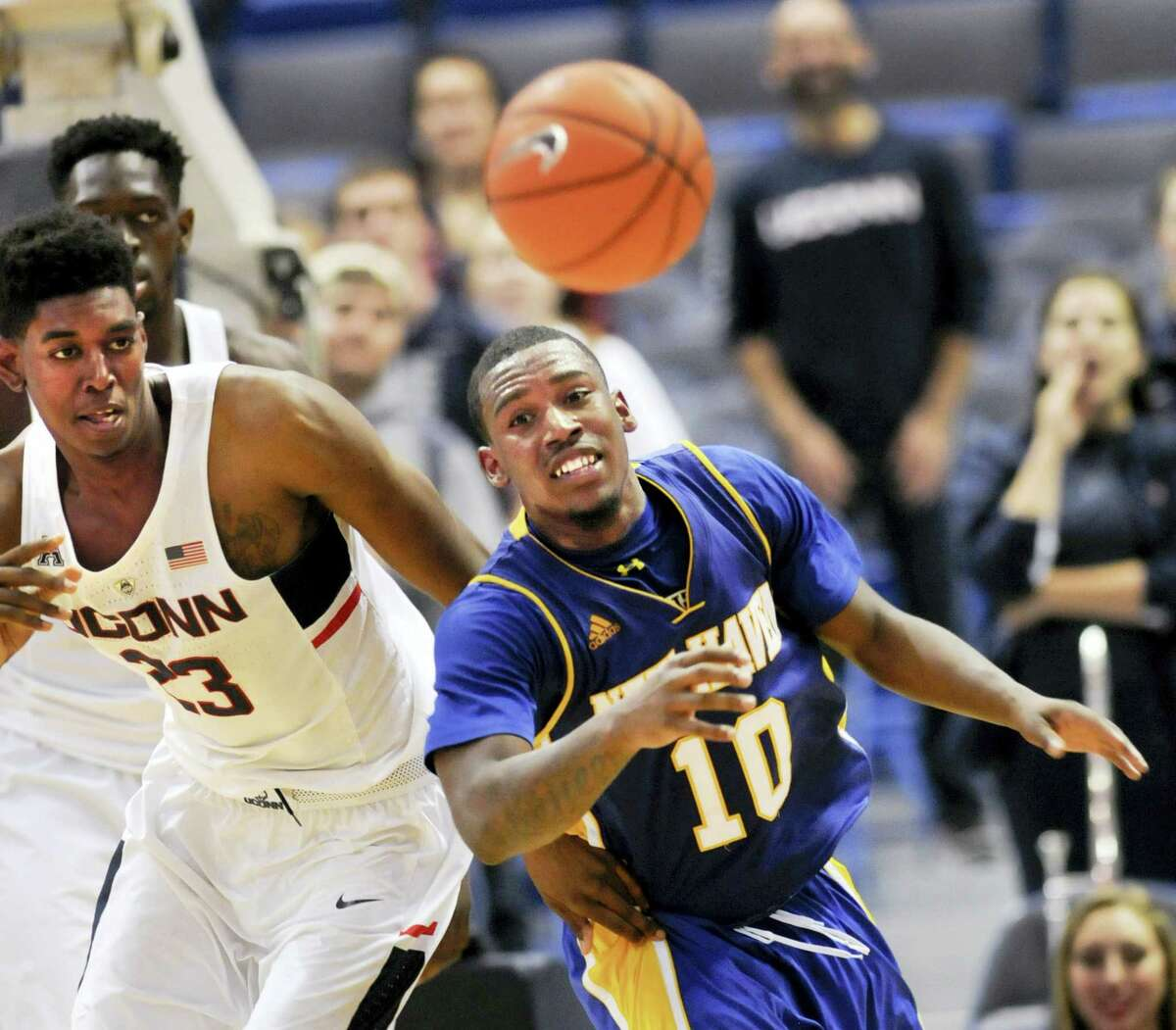 UConn's Juwan Durham (23) chases a rebound with New Haven's Danny Upchurch during the second half on Sunday.